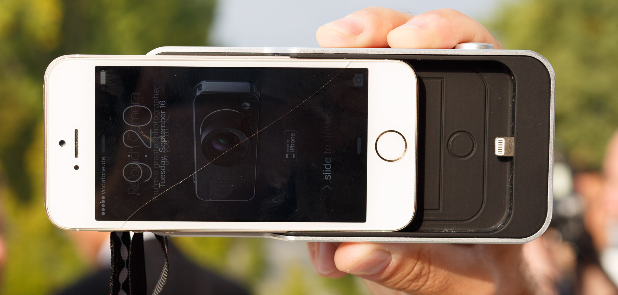 The iPhone slots into the Relonch Camera, linking with the Lightning connector.