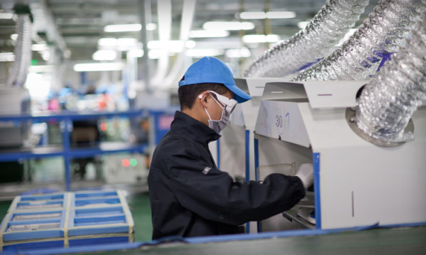 A worker at an Apple facility in Chengdu, China.