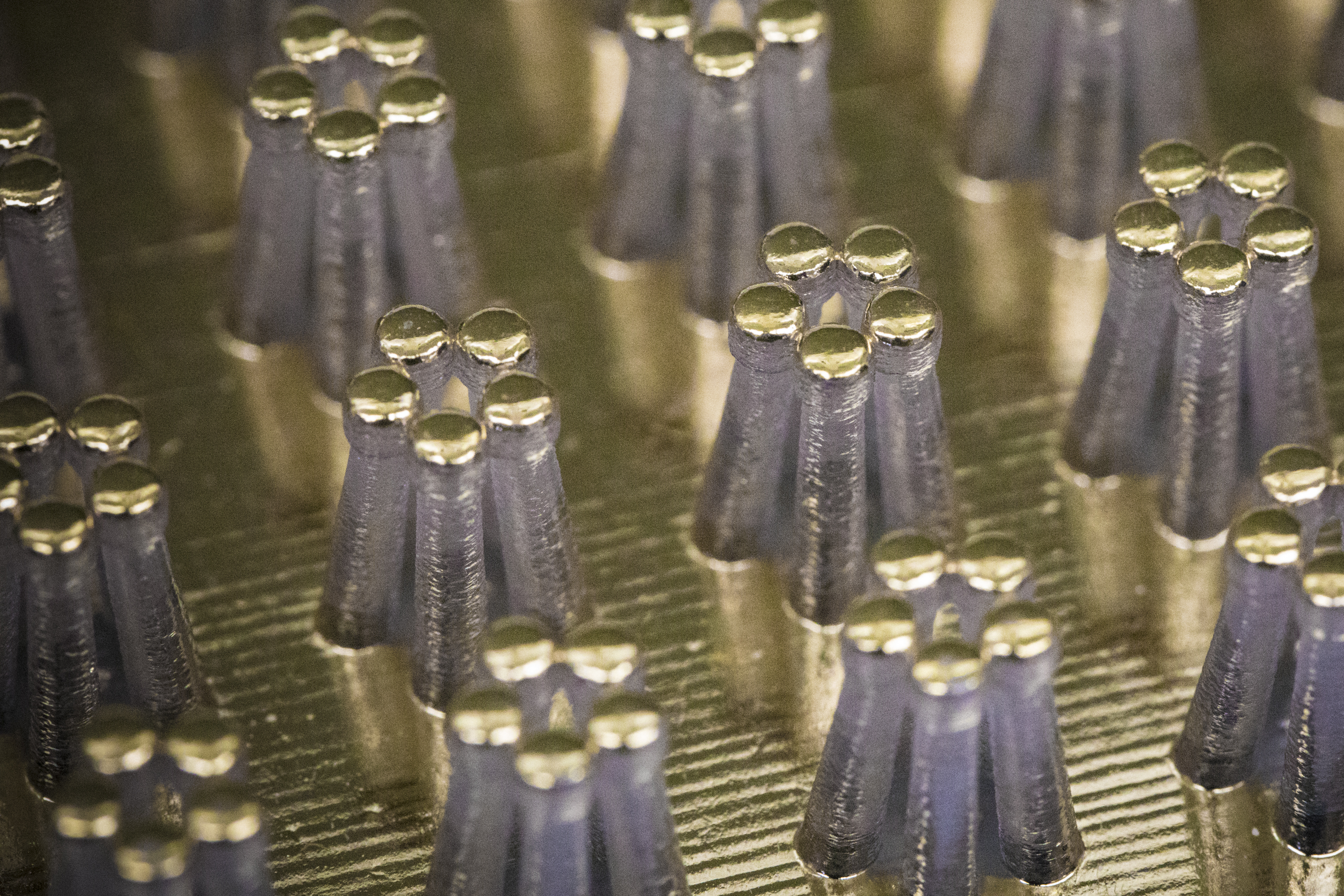 This model of HP Lab's nanofingers, thousands of times larger than the real-world item, shows the pillars that can effectively grasp individual molecules for analysis.