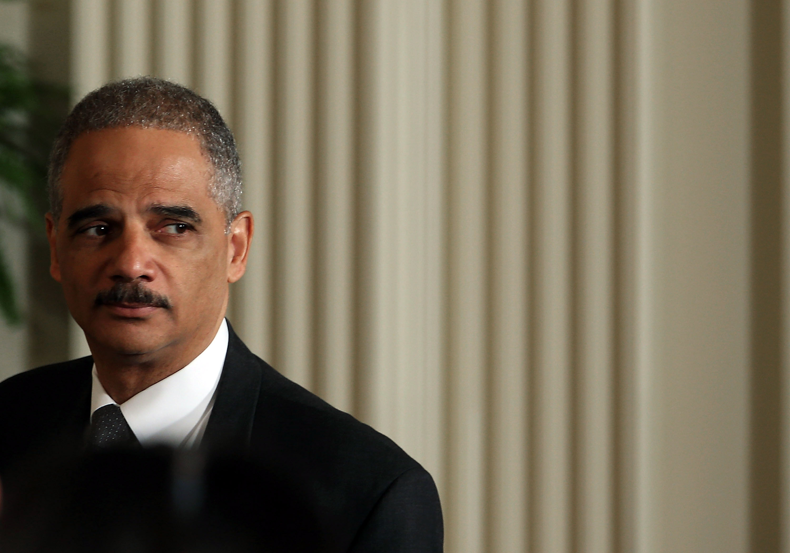 Attorney General Eric Holder, shown here earlier today, has not permitted Google to disclose what information it is -- and isn't -- forced to turn over to the feds.