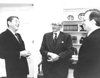 The Heritage Foundation, President Reagan's favorite think tank and longtime copyright hawk, is now warning of the dangers of SOPA. From left: Ronald Reagan, Nobel laureate F.A. Hayek, and Heritage President Ed Feulner.