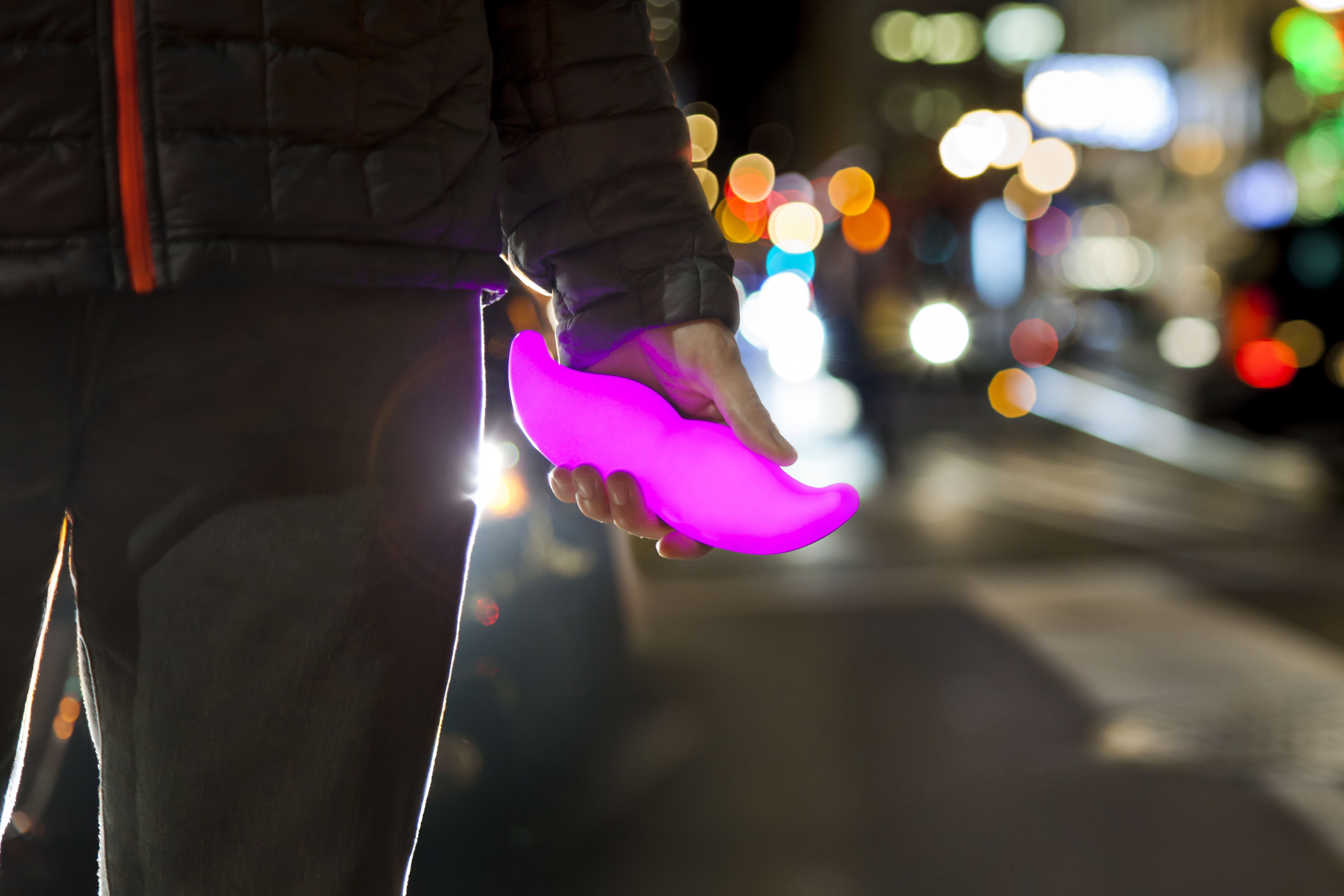 Ride-hailing service Lyft distinguishes itself with a glowing pink mustache that drivers place on their dashboard.