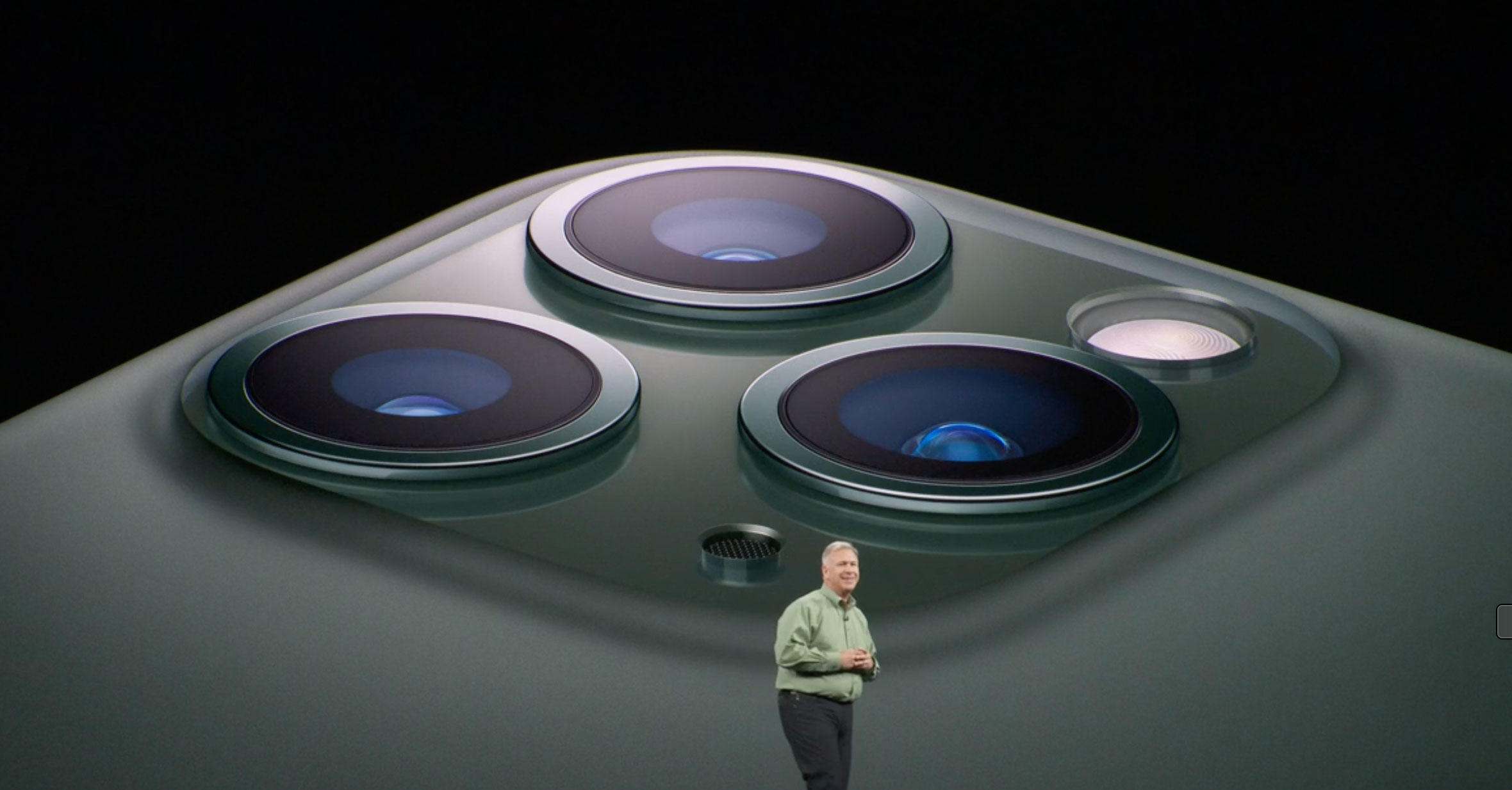 Apple marketing chief Phil Schiller shows off the iPhone 11 Pro's three cameras.