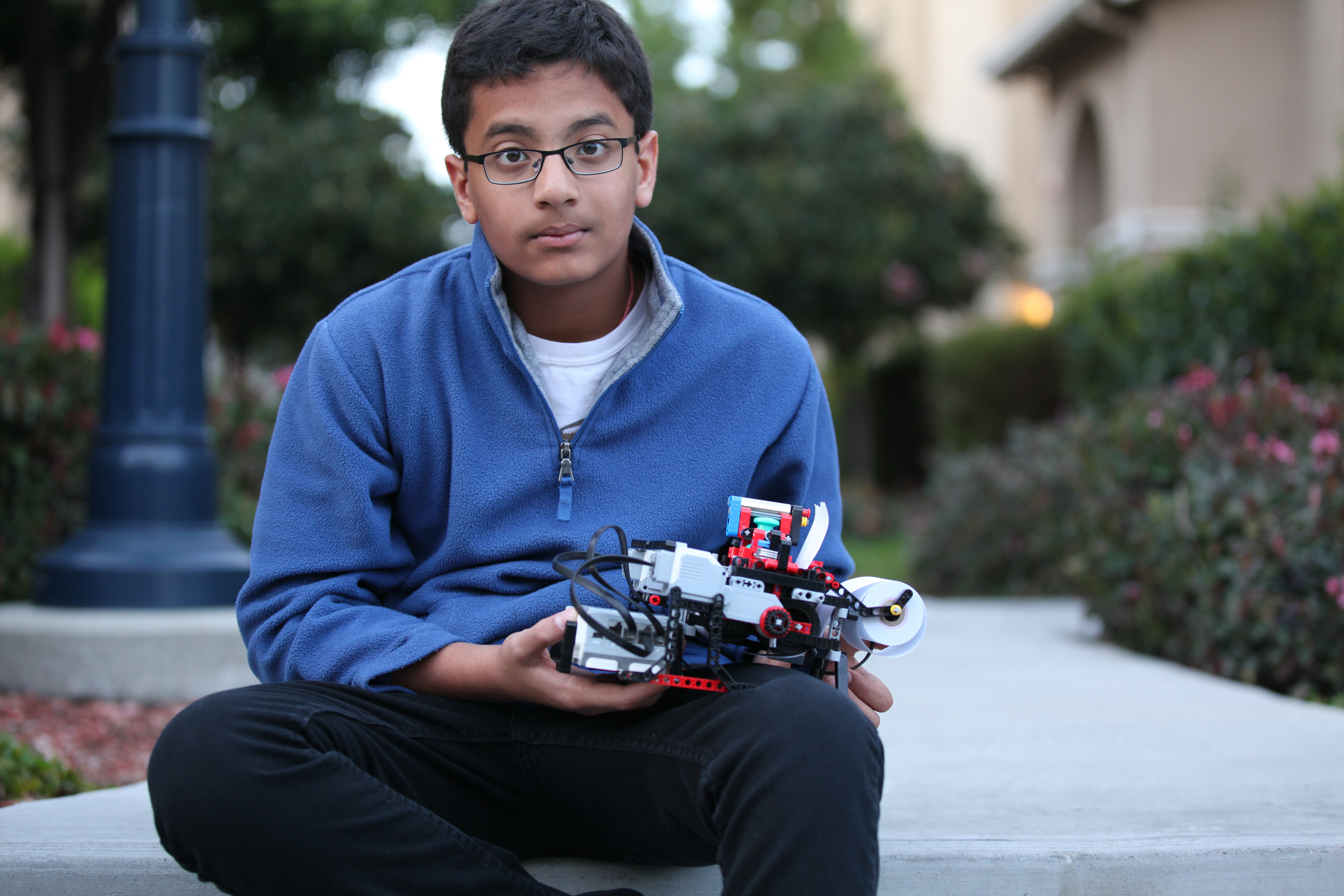 Shubham Banerjee with the braille printer