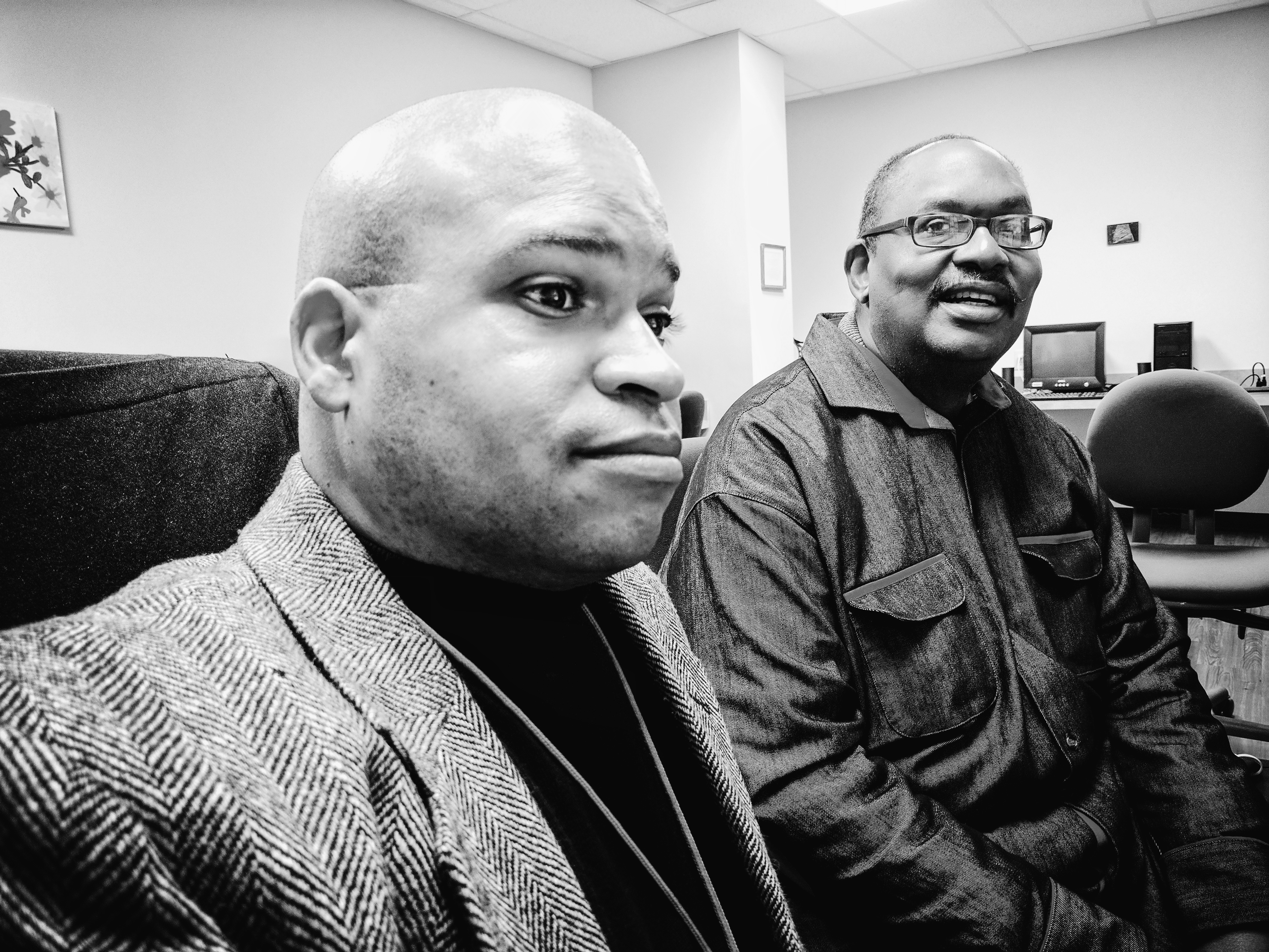 Dante Murray (left) shows the computer literacy skills he teaches clients to help improve employability.
