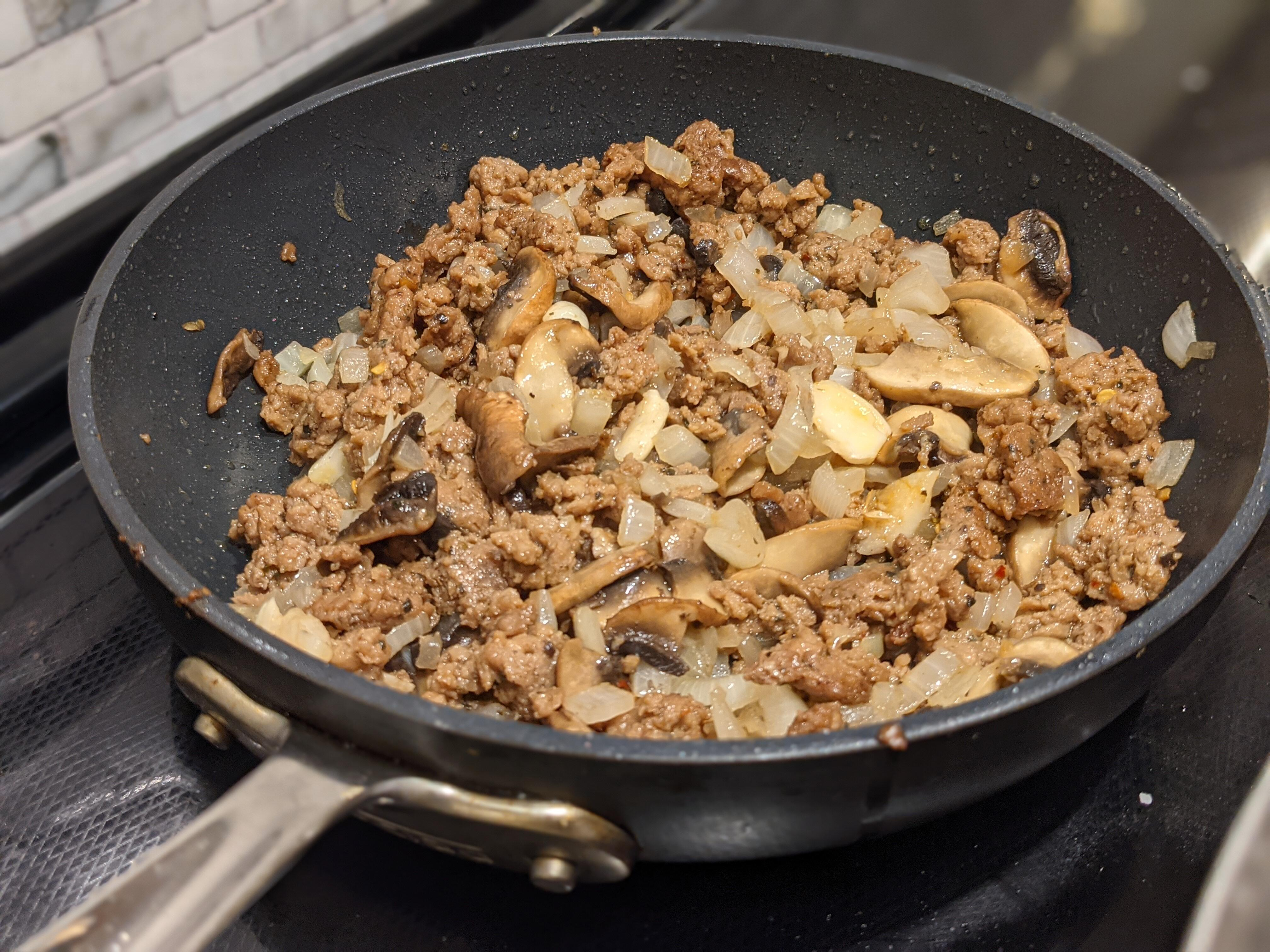 Impossible Sausage browning in a pan
