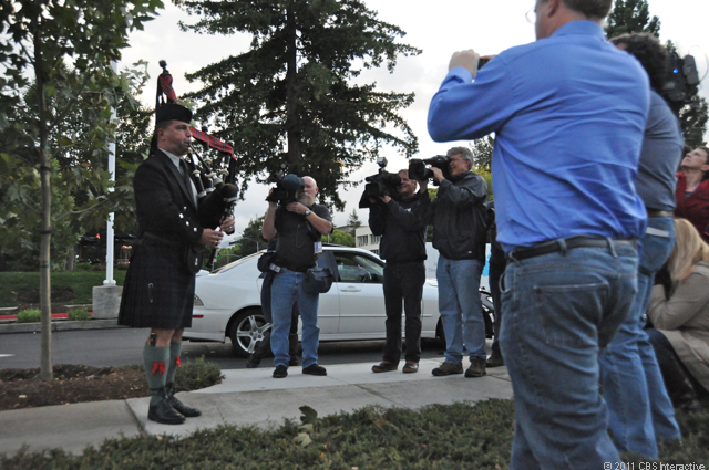 A bagpiper plays at Apple headquarters.