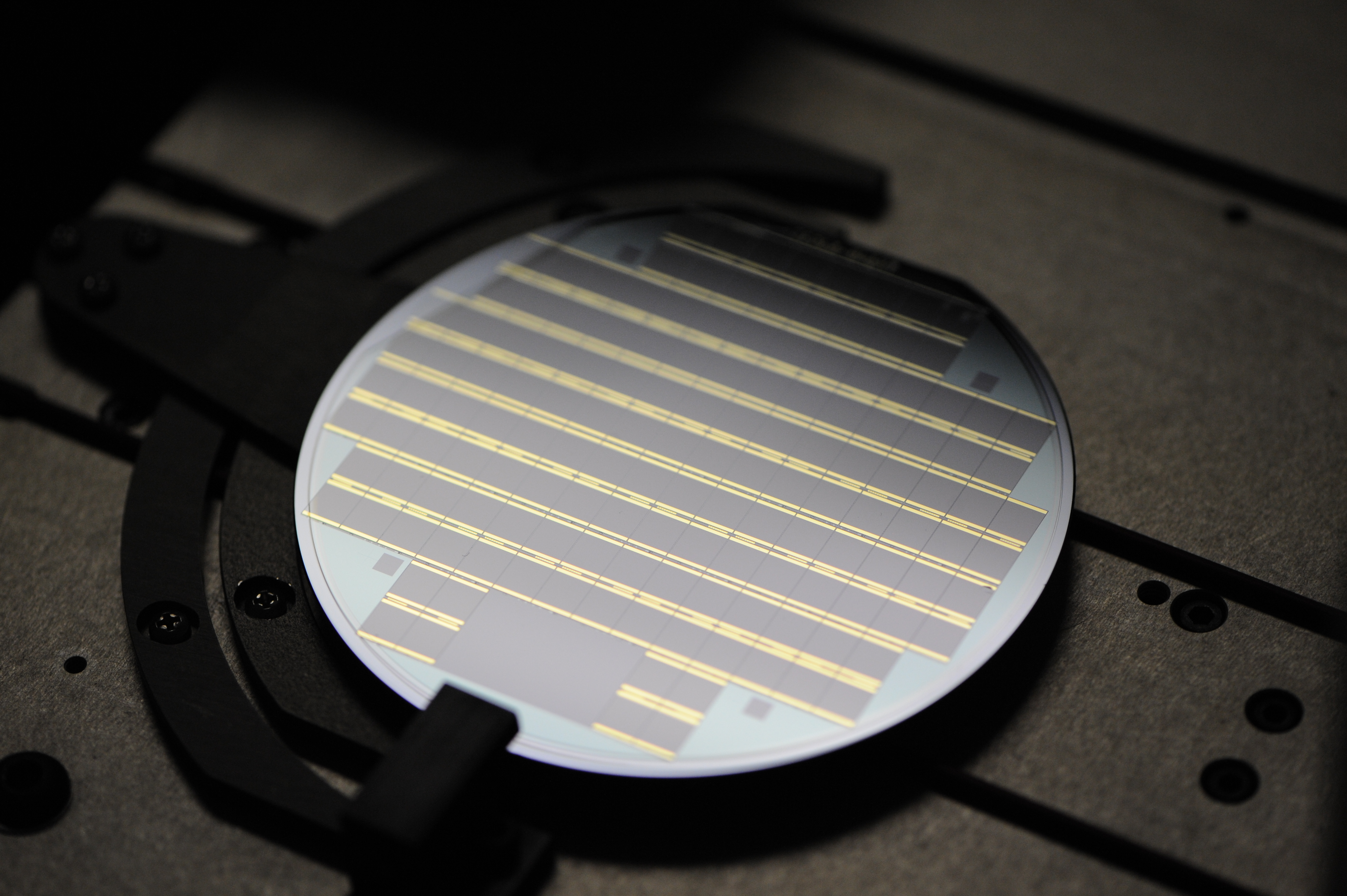 A Solar Junction wafer of high-efficiency solar cells. Each individual chip can produce about 20 watts.