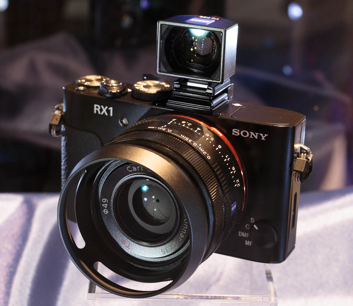 The Sony RX1 comes with an optional viewfinder, shown here perched atop the camera body in the flash hot shoe. The camera comes with a Carl Zeiss lens, too.