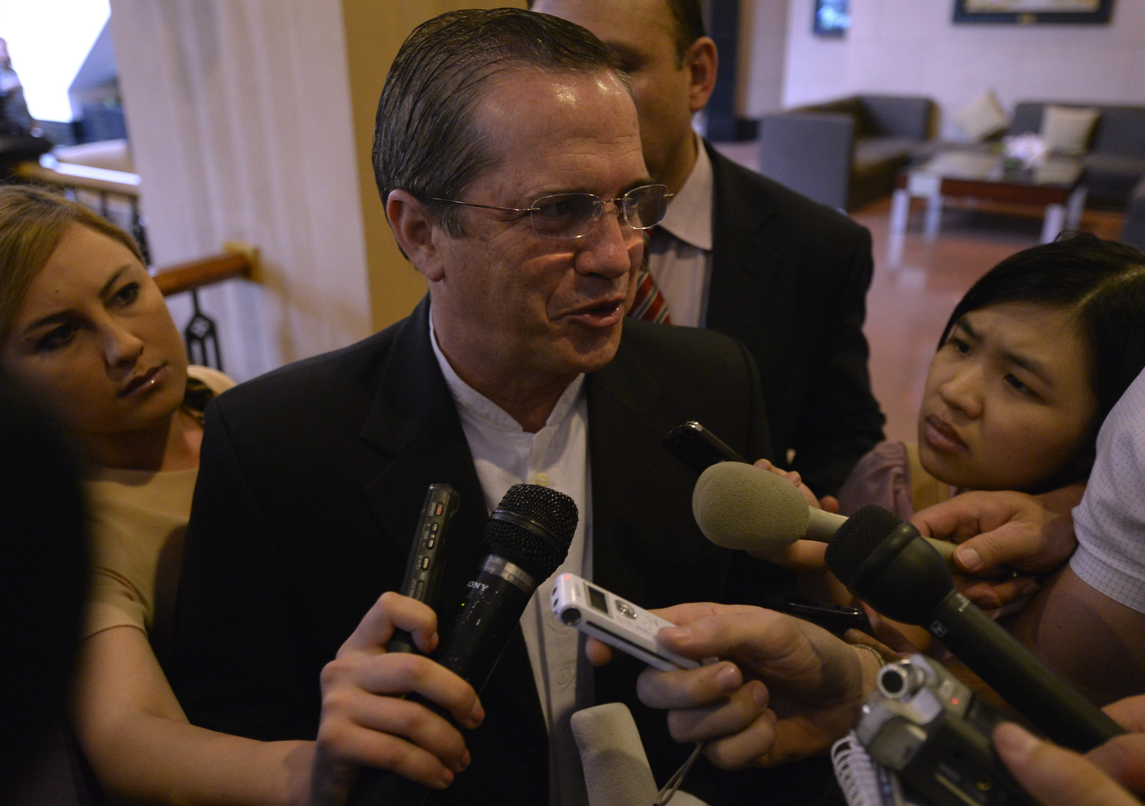"""Ecuador's Foreign Minister Ricardo Patino, while visiting Vietnam today, tells reporters his country is """"analyzing"""" Edward Snowden's request for asylum."""