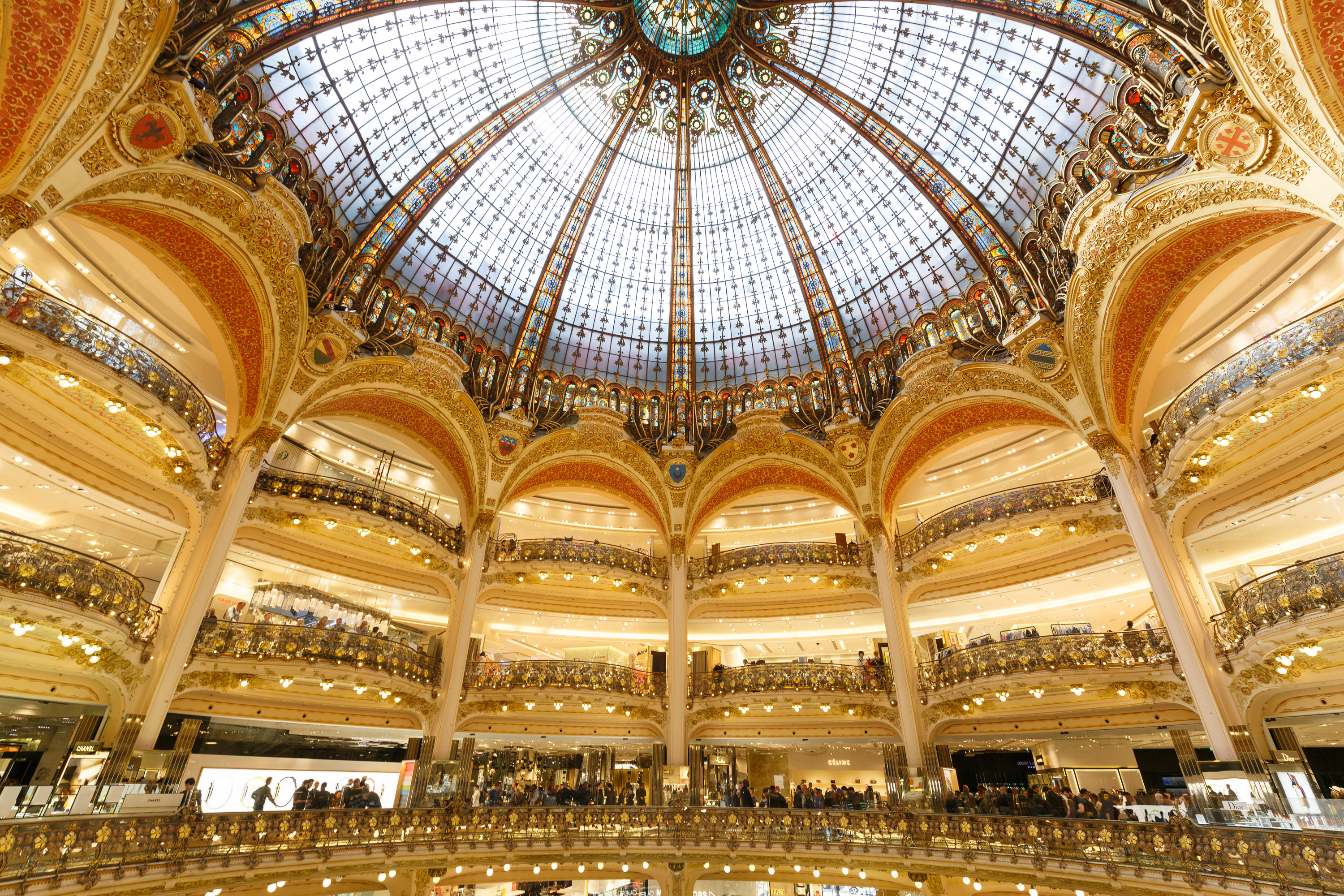 The Apple Watch display at the Galeries Lafayette in Paris occupied prime retail territory: four bays beneath the building's glass atrium.