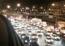 """Taxis protesting """"VTC"""" car services like Uber or AlloCab blocked traffic in Paris."""