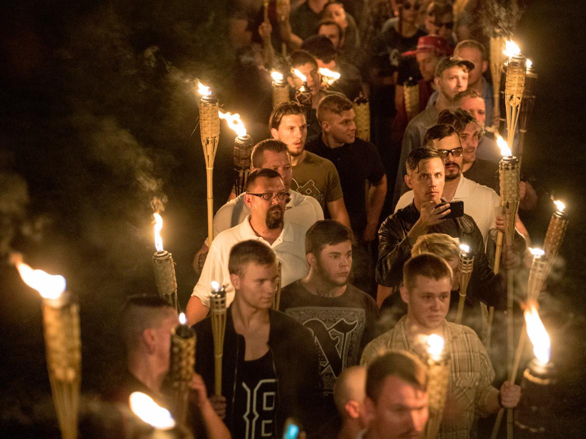 White supremacists march with tiki torches through the University of Virginia campus the night before the Unite the Right rally in Charlottesville last August.