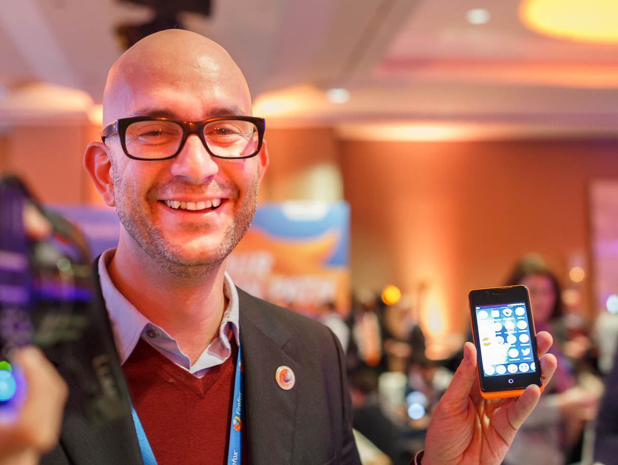 Carlos Domingo, Telefonica Digital's director of product development and innovation, holds a Geeksphone Keon Firefox OS phone.
