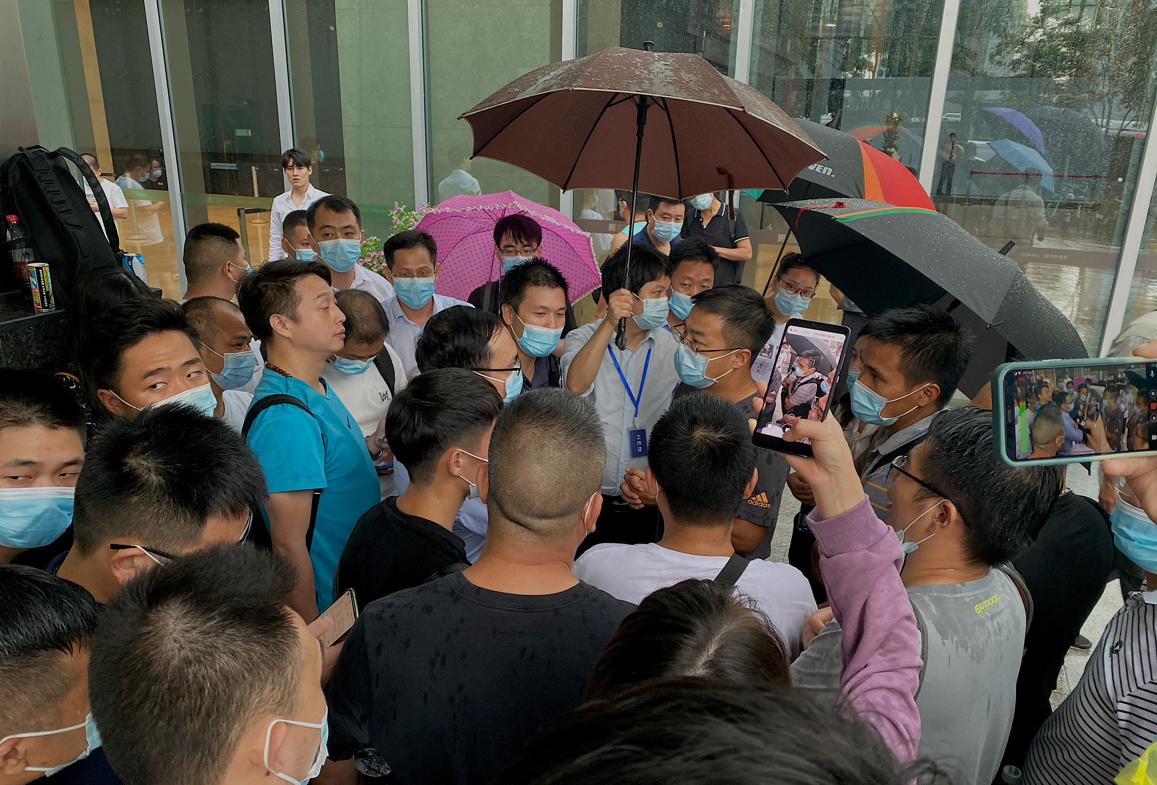 Throng of people outside an Evergrande office