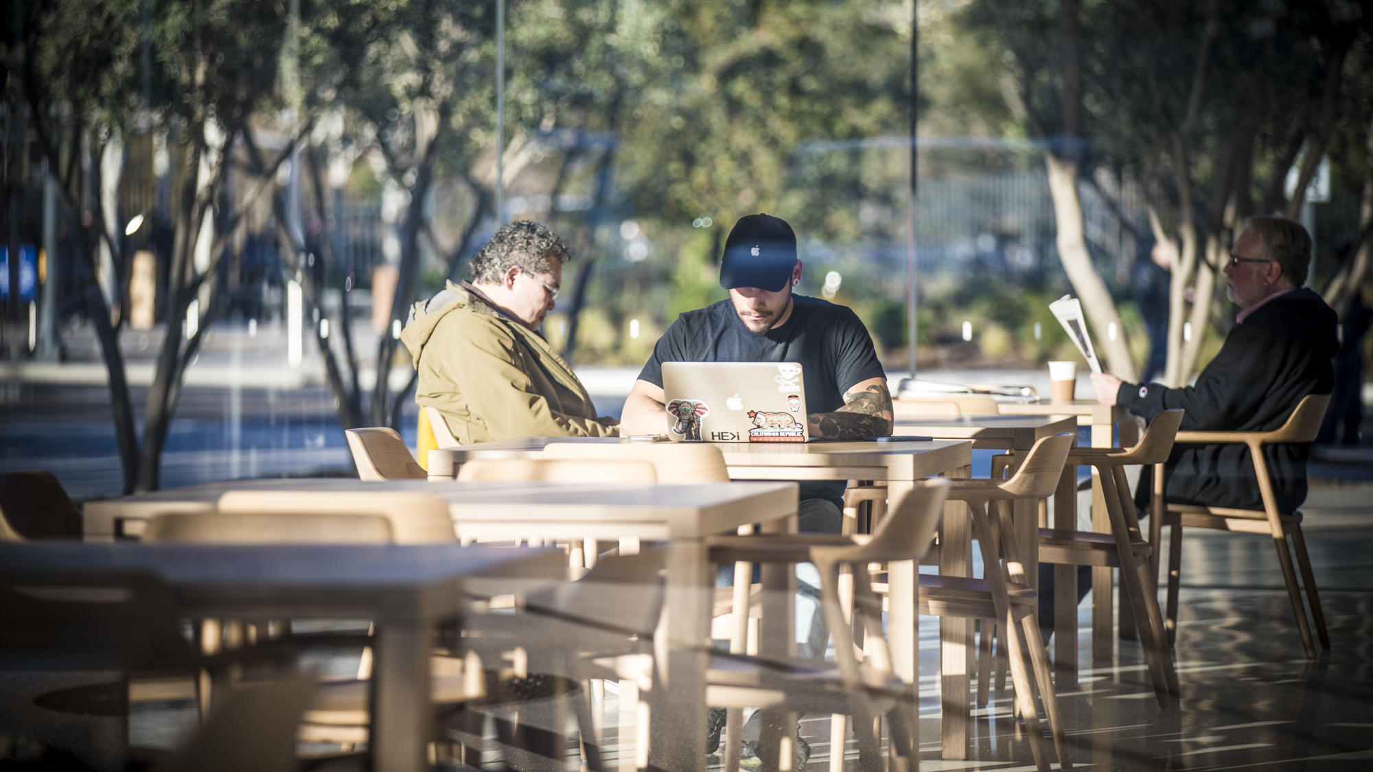 People hanging out at the new Apple campus.
