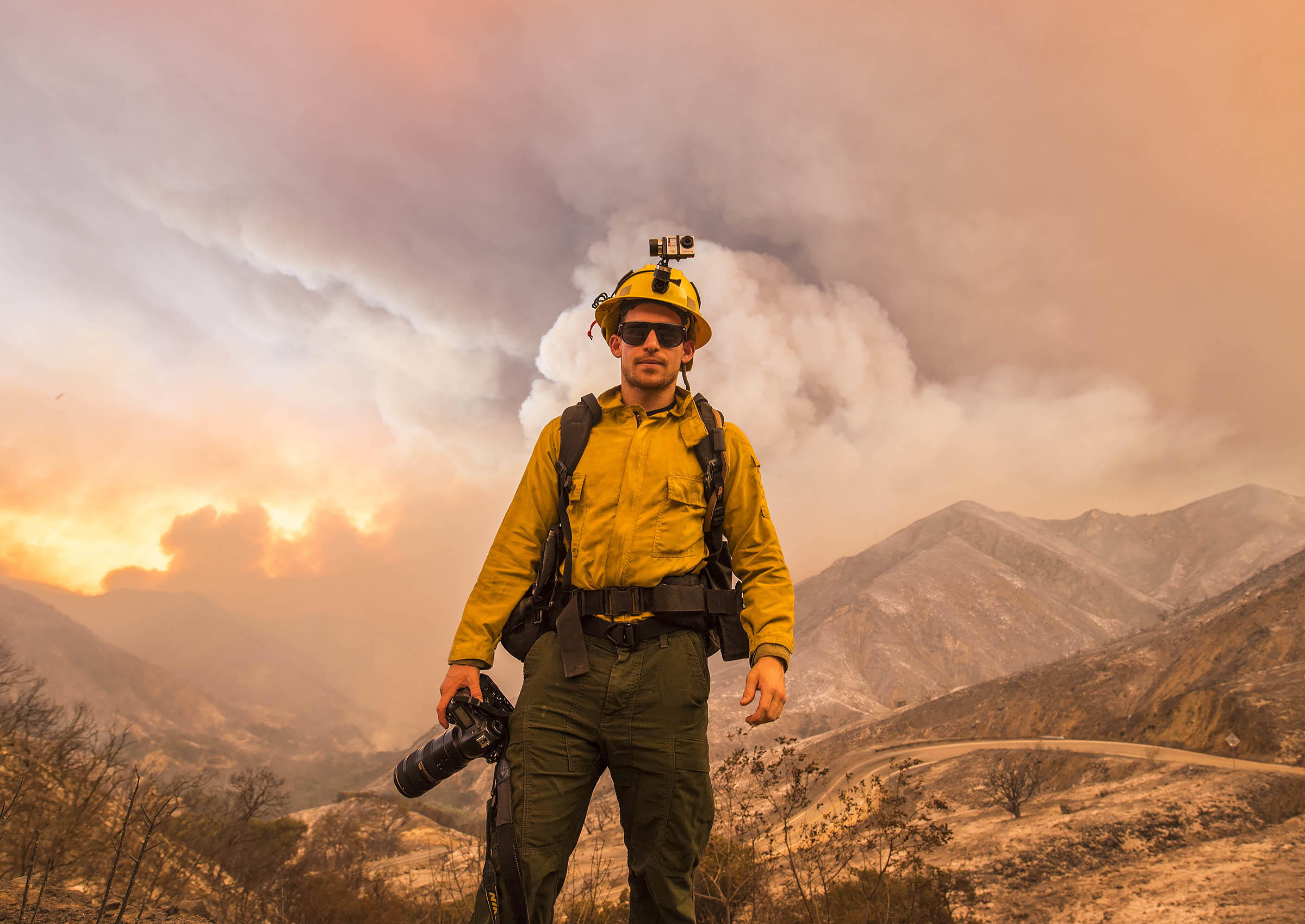 Stuart Palley, a professional wildfire photographer standing in the Angeles National Forest, believes mirrorless cameras will replace conventional SLRs.