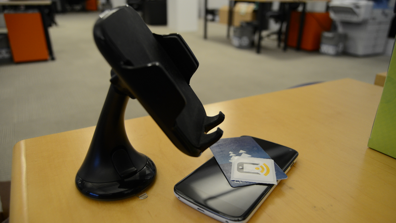 Car cradle, phone, NFC stickers, and transit card