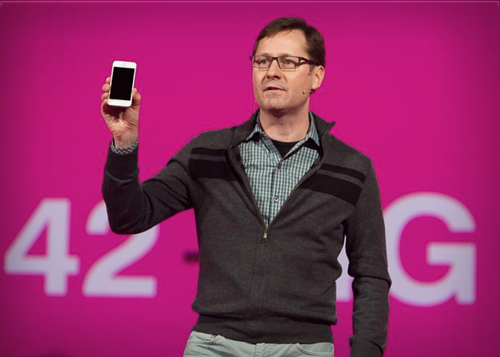T-Mobile's Chief Marketing Officer Mike Sievert holds aloft the long-awaited T-Mobile iPhone 5 at an event in New York March 26, 2013.