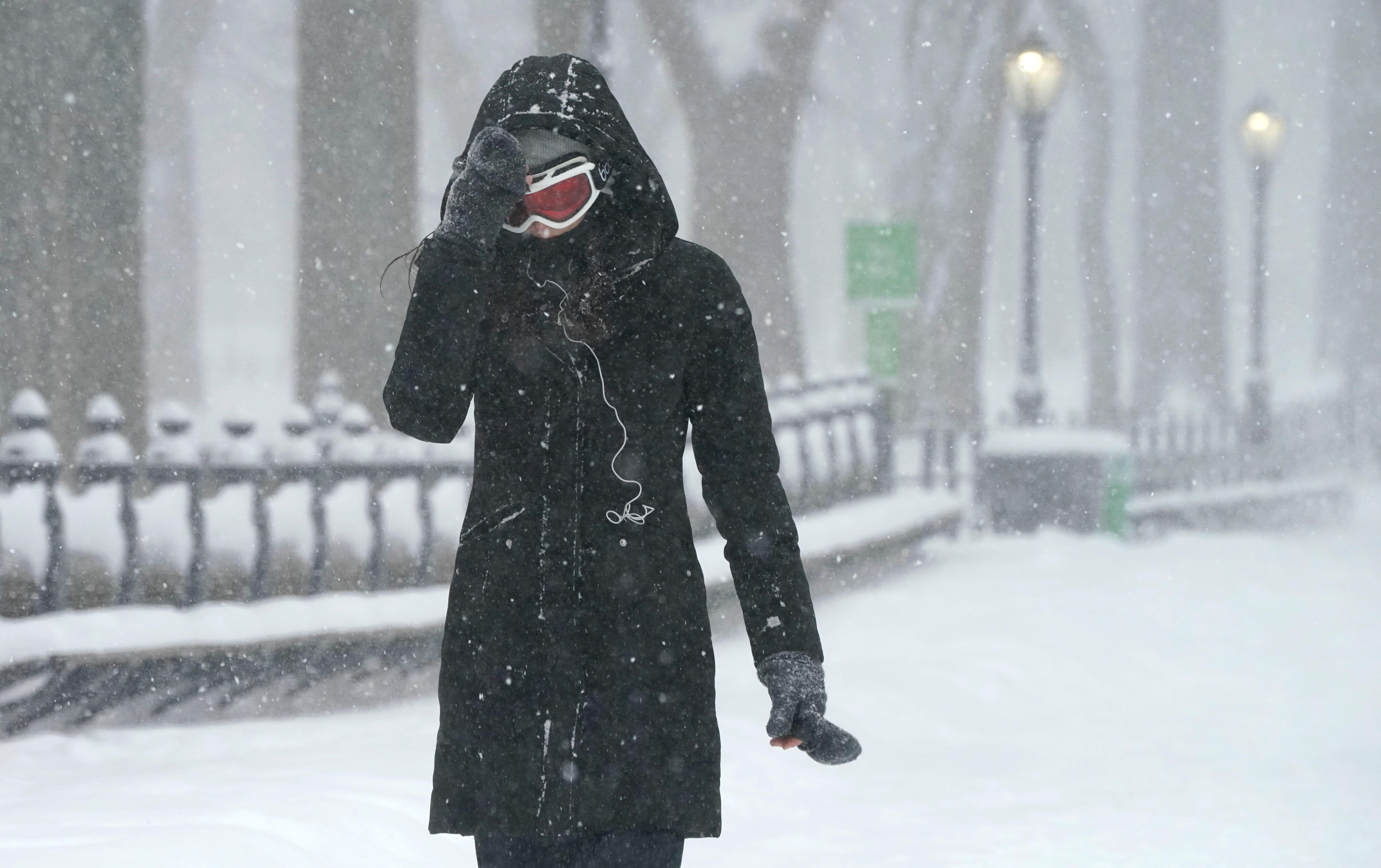 Woman walking in snowstorm in New York's Central Park
