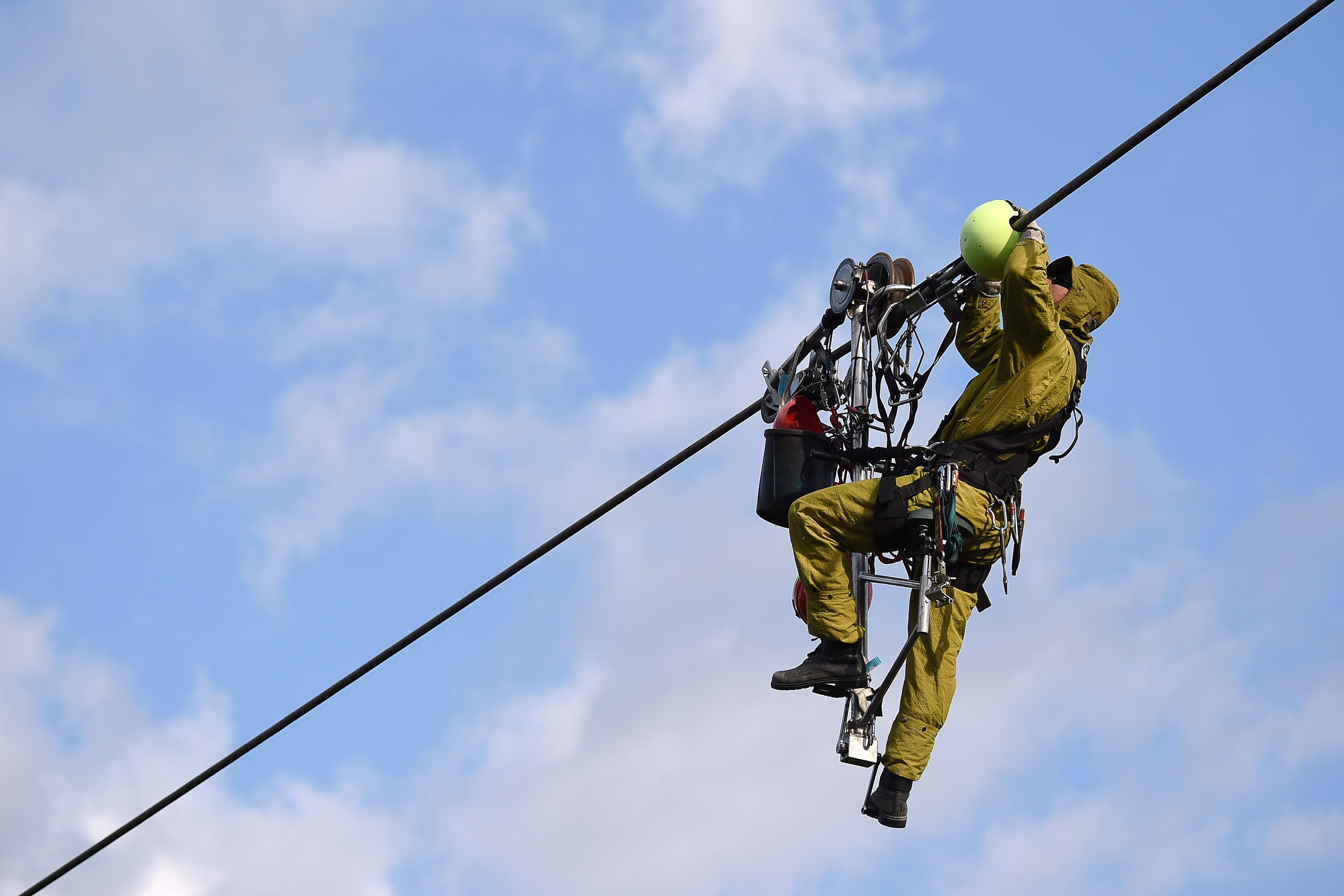 9. Electrical line workers