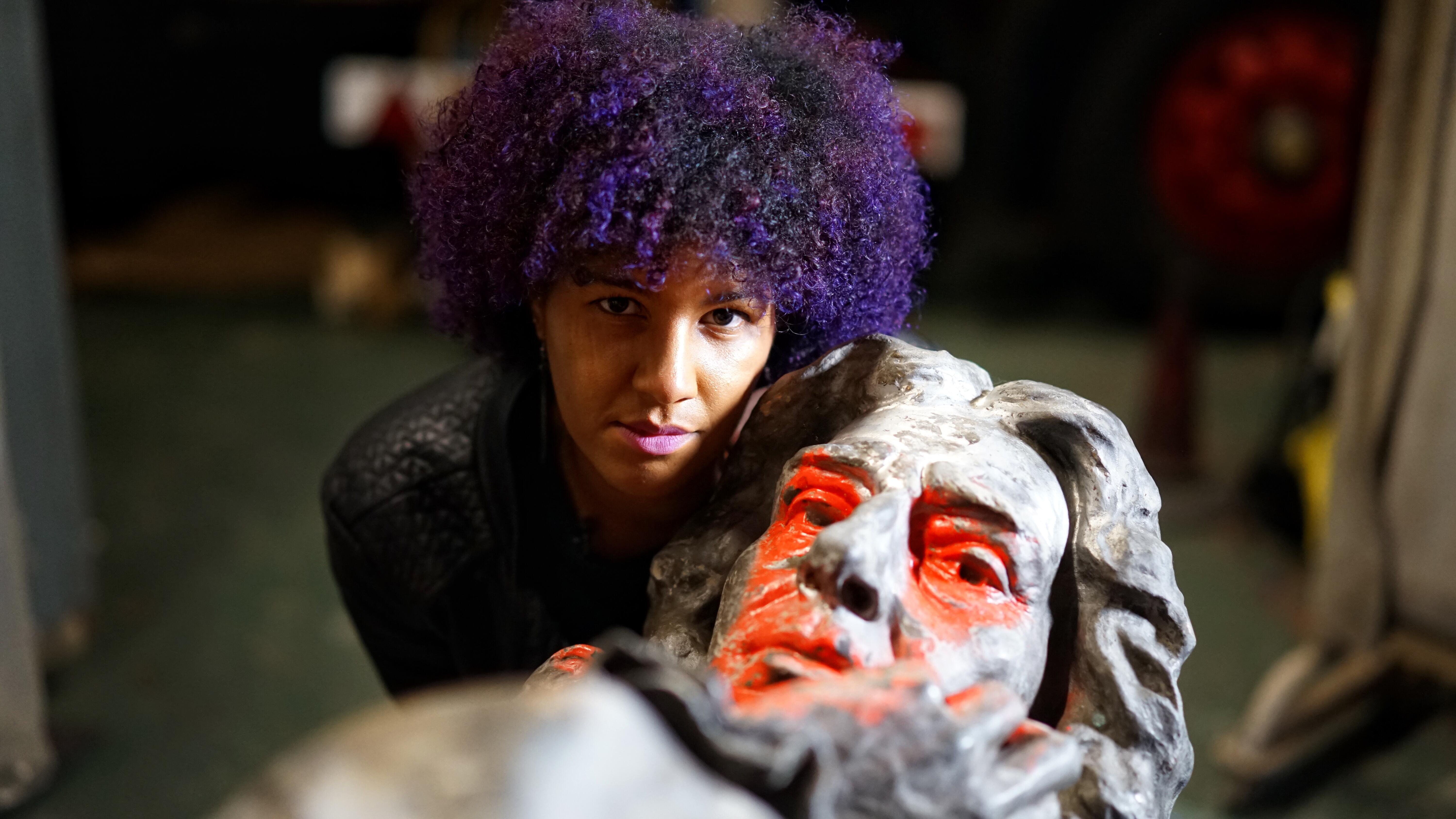 ngaio-anyia-with-the-statue-of-edward-colston-copyright-bbc