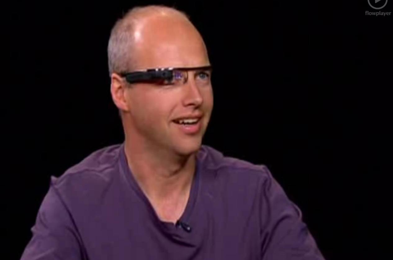 Sebastian Thrun of Google X operate's Google's wearable computer glasses during an interview with Charlie Rose.