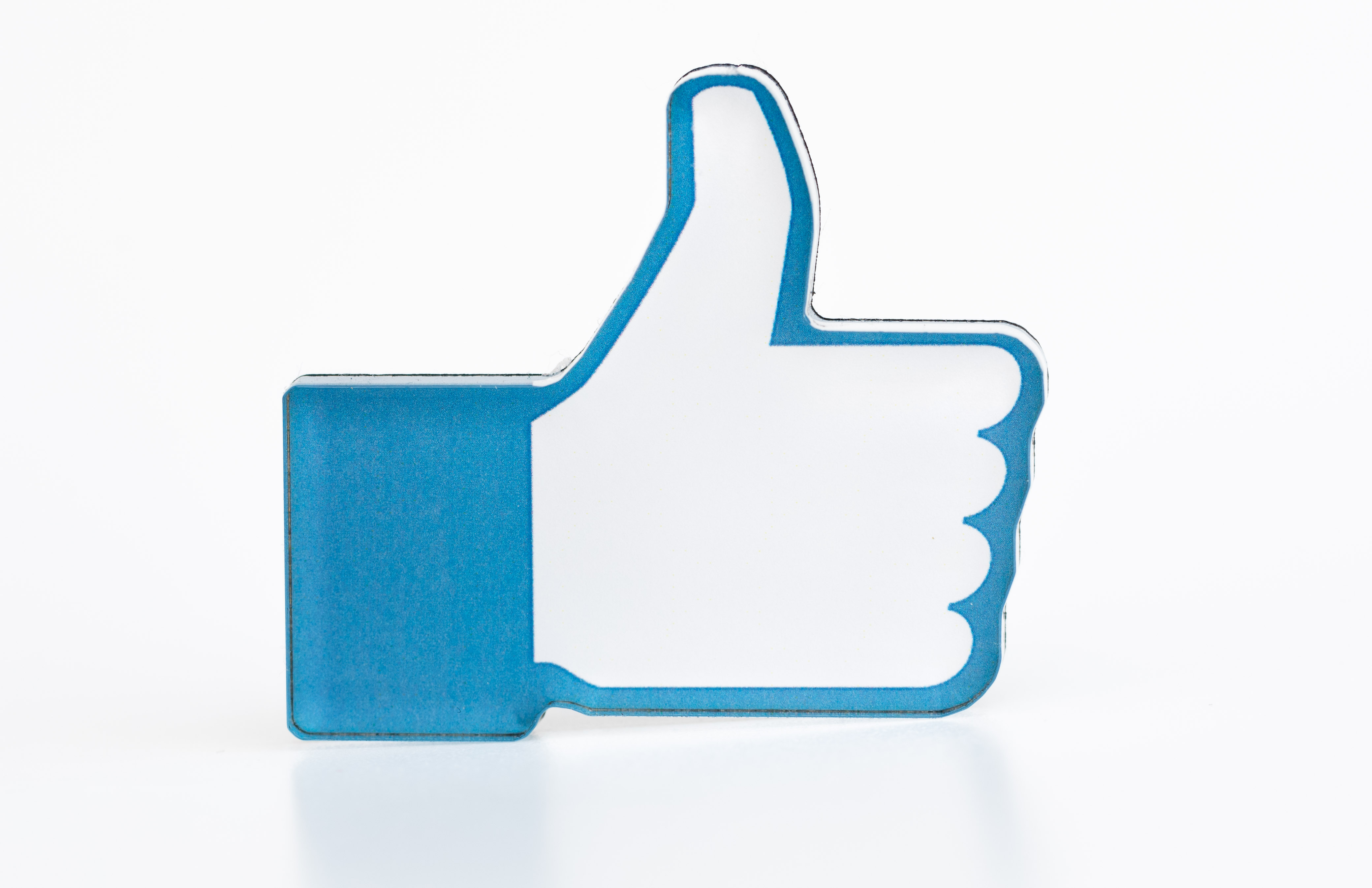 A promotional sticker shows Facebook's thumbs-up graphic.