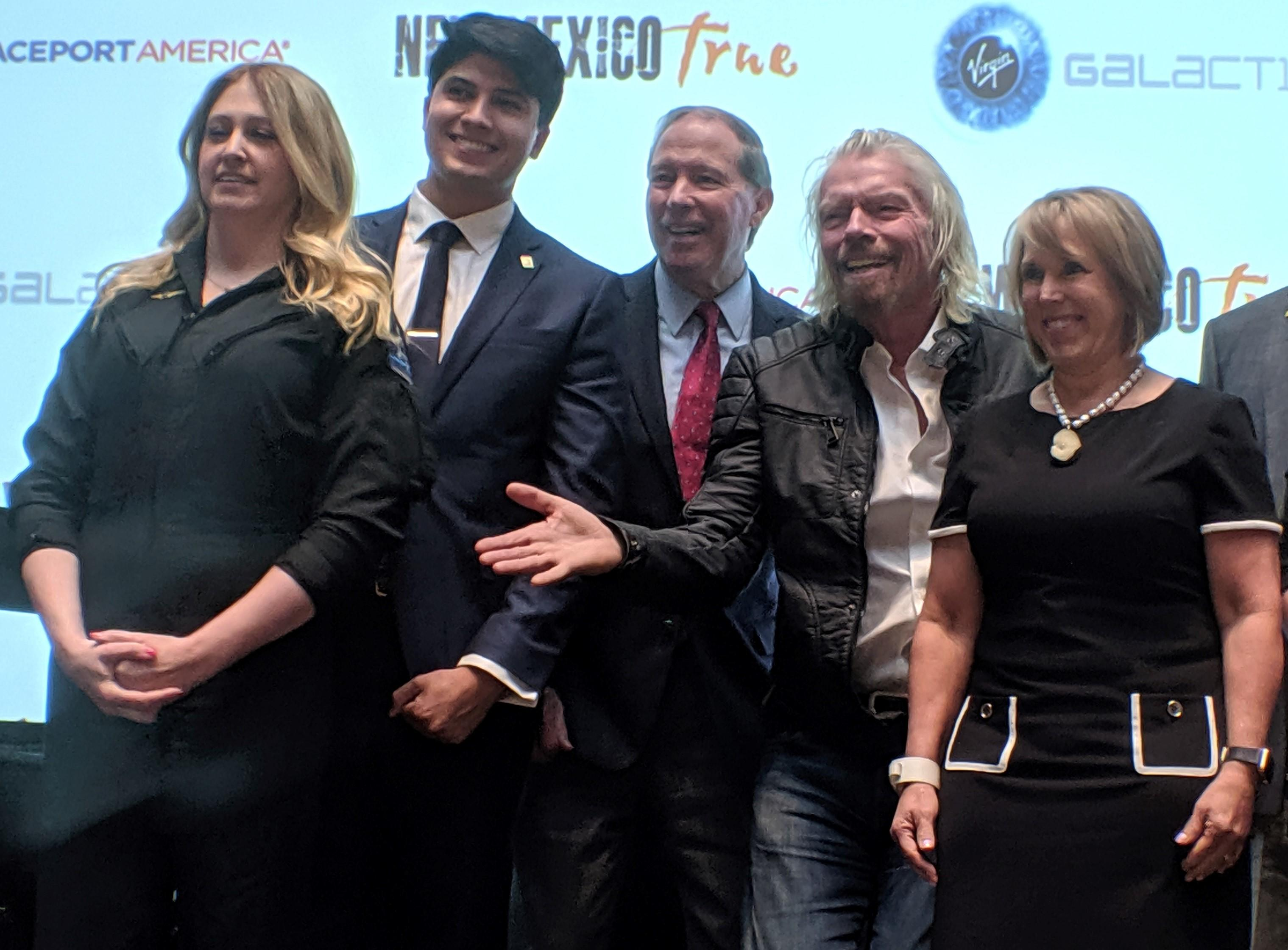 From left to right: Virgin Galactic's first passenger and chief astronaut instructor, Beth Moses, employee Kevin Prieto, Sen. Tom Udall, Richard Branson and New Mexico Gov. Michelle Lujan Grisham.