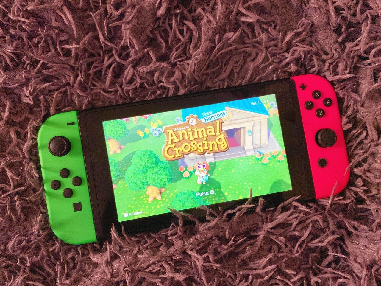 Nintendo Switch with Animal Crossing: New Horizons on the screen
