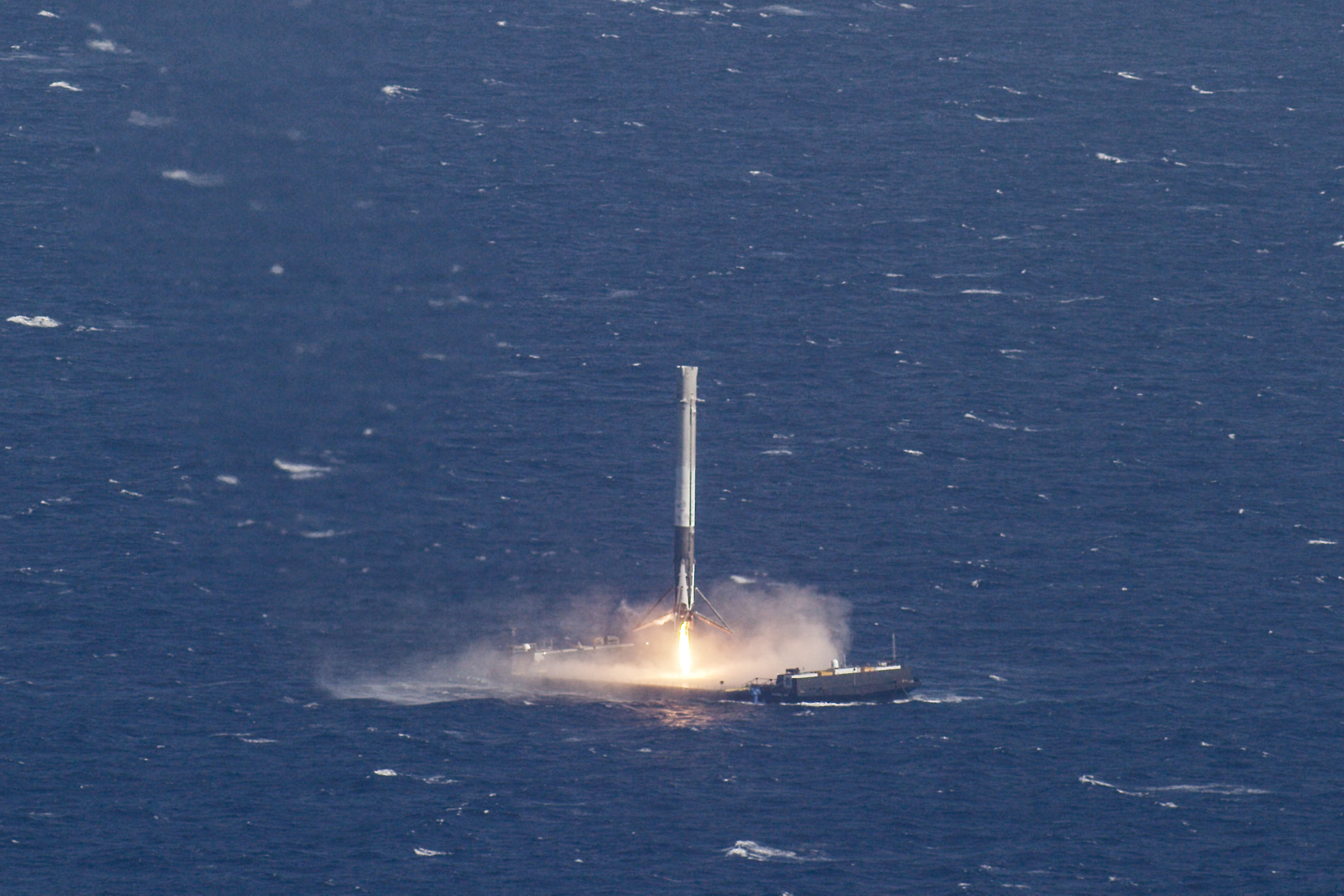 SpaceX's Falcon 9 rocket makes its first successful landing at sea, April 8, 2016.