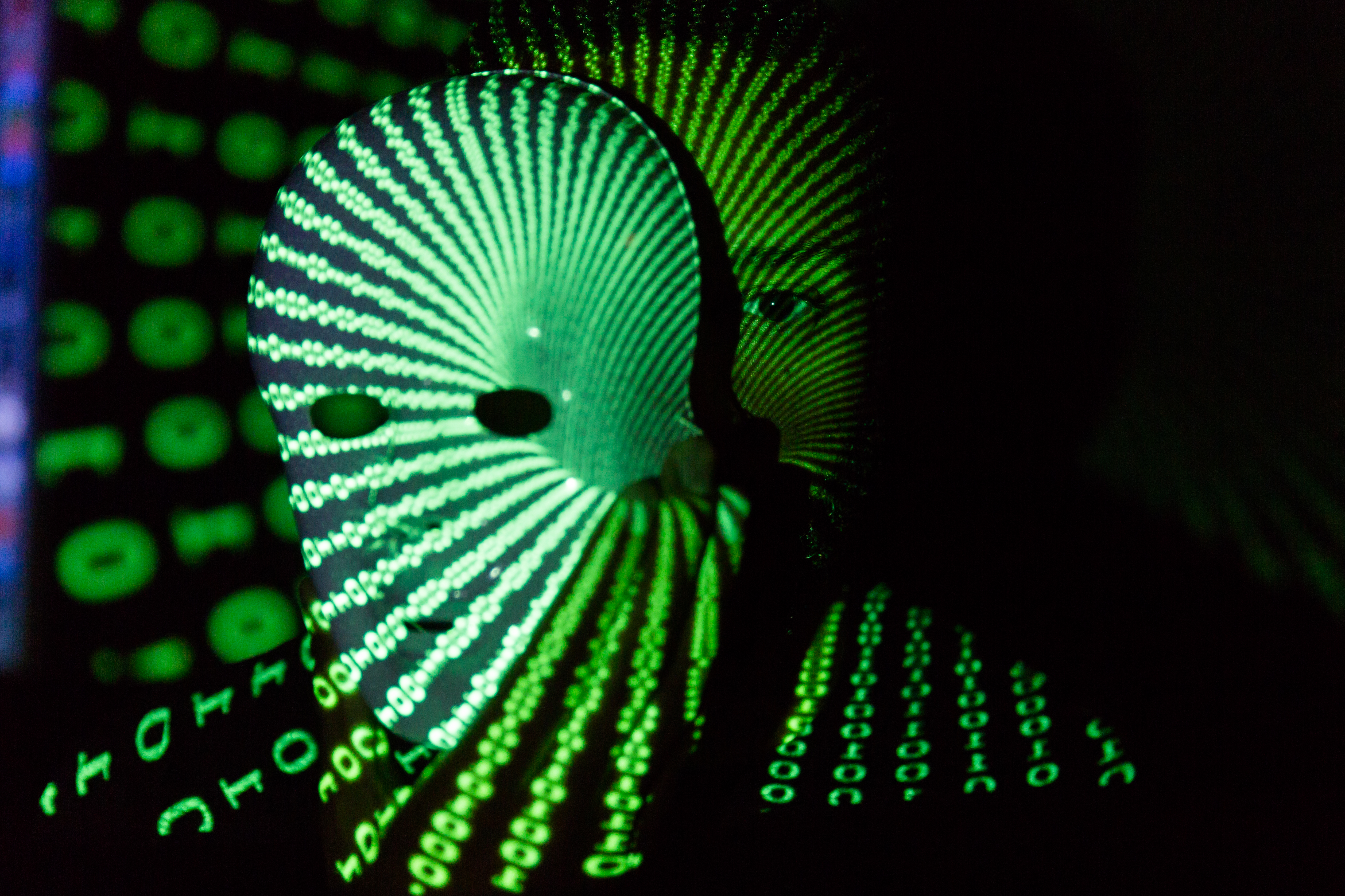 An illustration of a man wearing a mask with green ones and zeroes projected over his face. Ransomware will likely get worse and data breaches aren't going anywhere in 2018. But there's still plenty you can do to protect yourself.