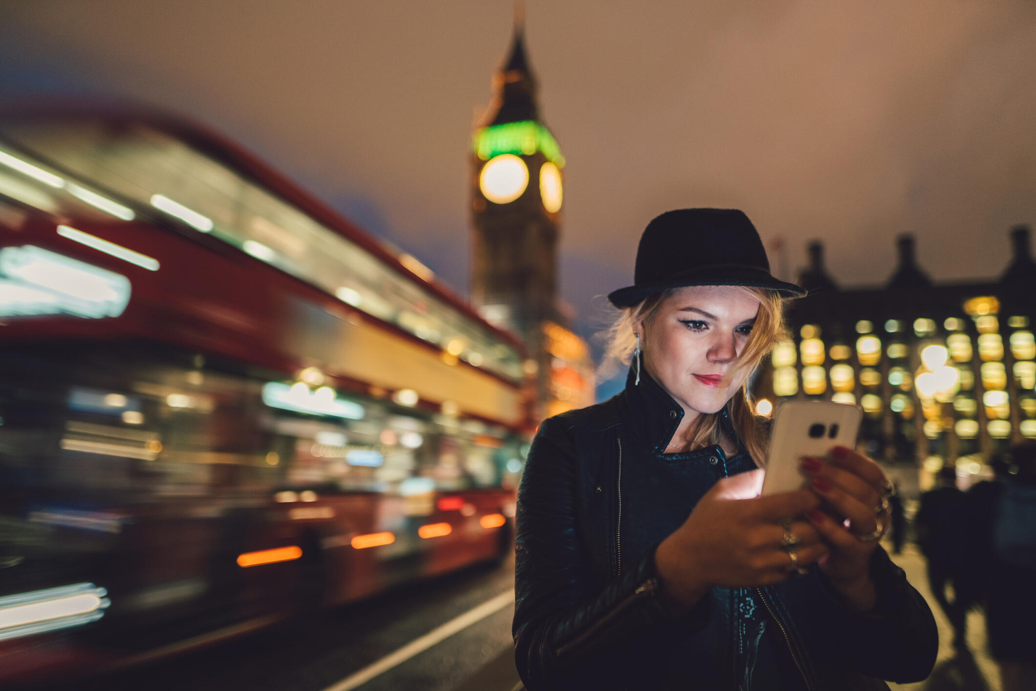 Woman using a phone in London