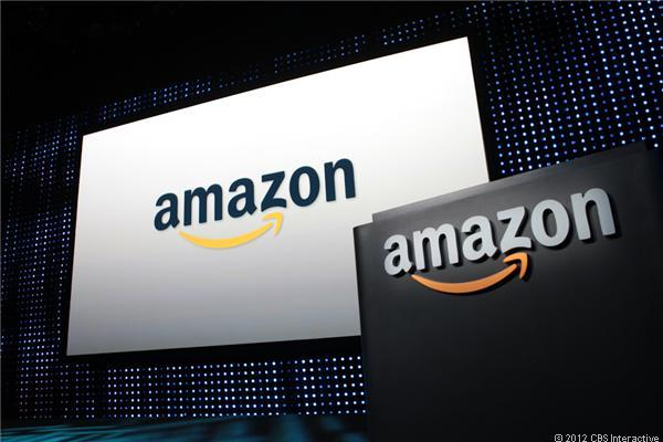 Amazon logos on a screen and lectern.