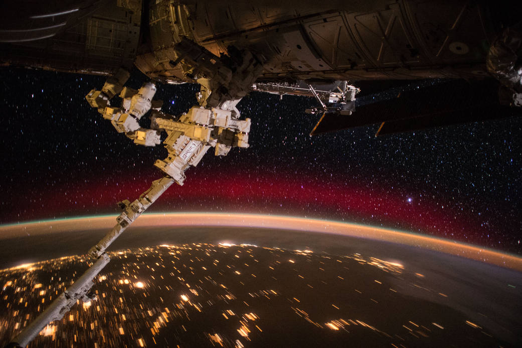ISS poses with an aurora