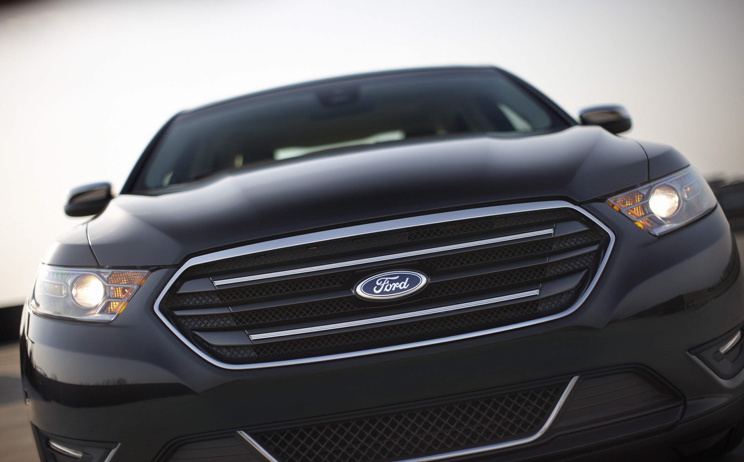 The 2013 Ford Taurus' new grill hides one of two new, more efficient engines.