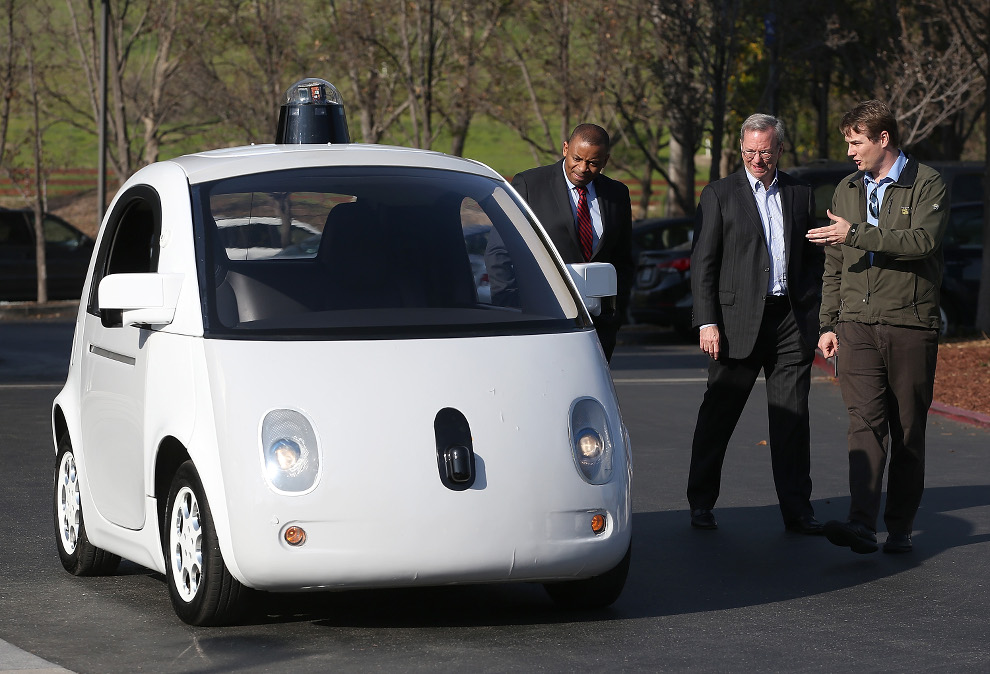 Urmson (right) shows a Google self-driving car to US Transportation Secretary Anthony Foxx (far left) and Google Chairman Eric Schmidt at Google headquarters last year.