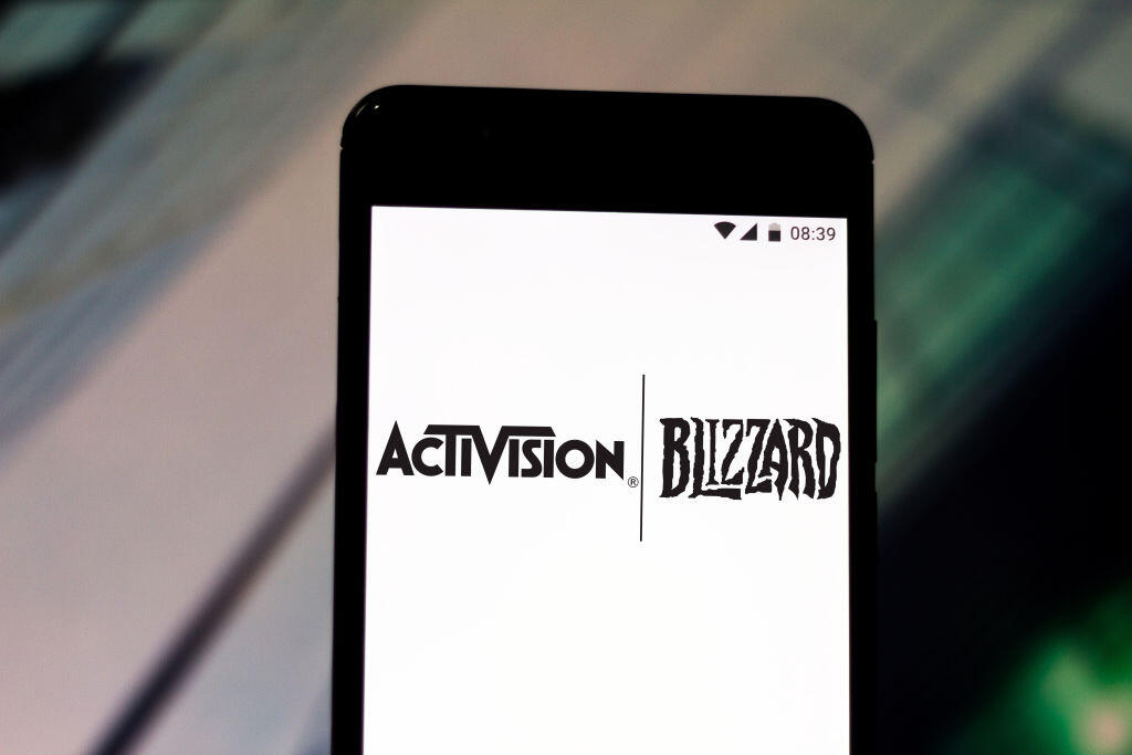Activision Blizzard logos on a phone screen