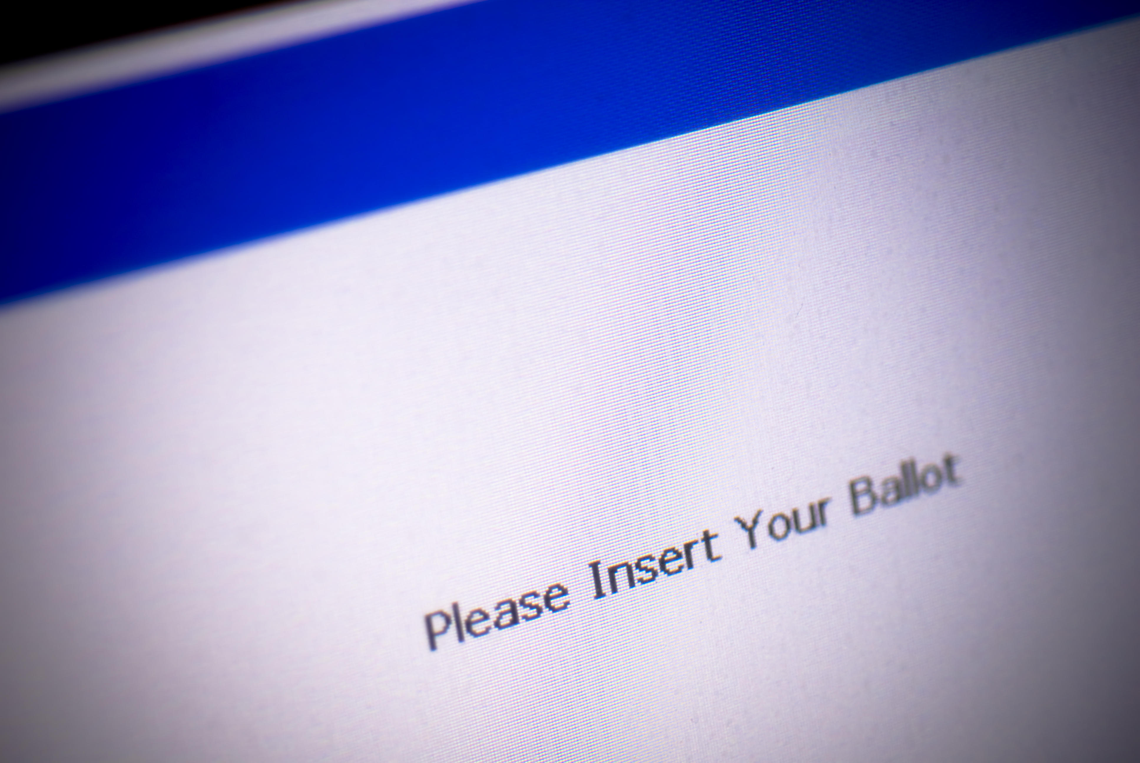 """Voting machine screen reads """"Please insert your ballot."""""""
