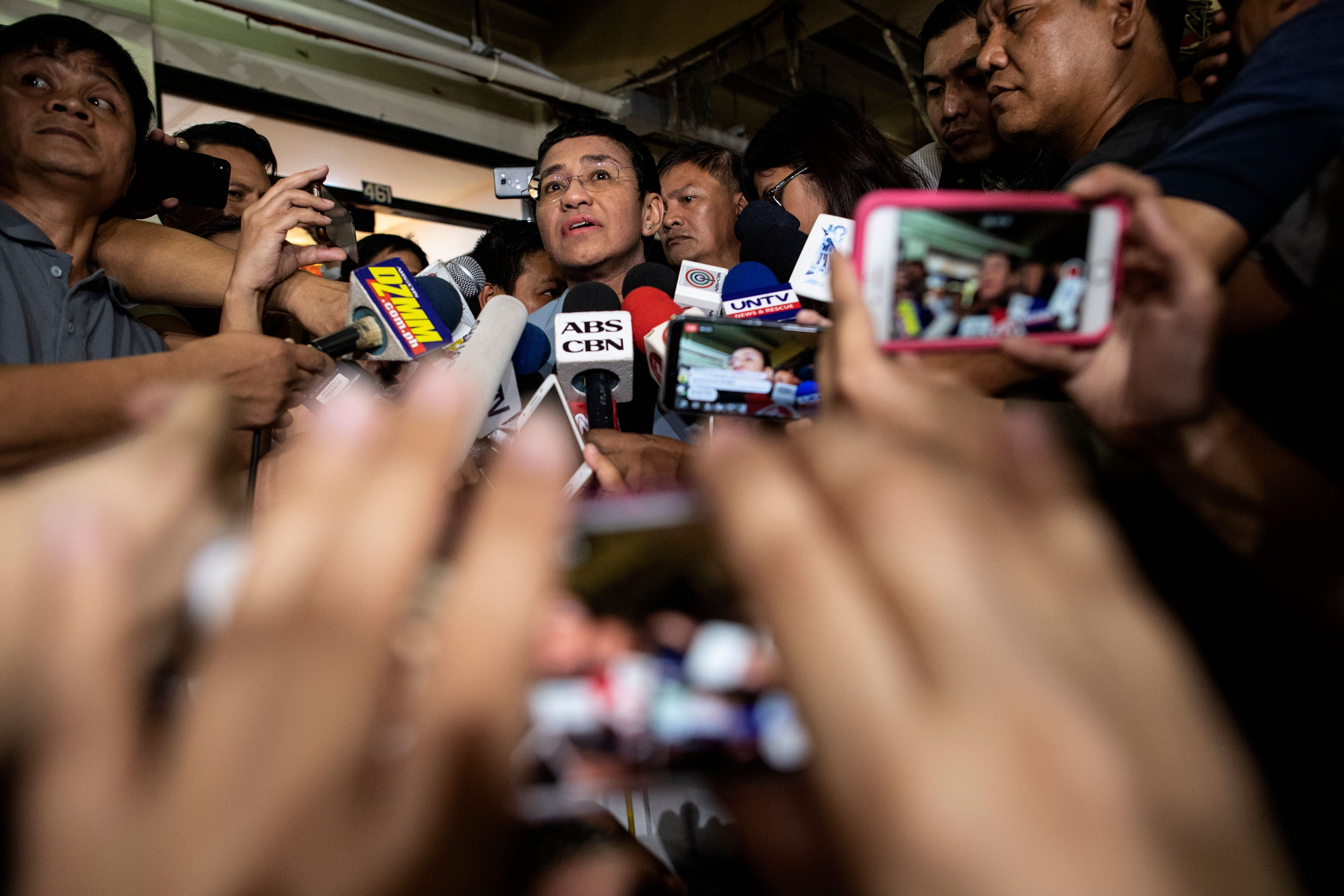 Philippine journalist Maria Ressa gives a statement after posting bail at a regional trial court in Manila in February 2019
