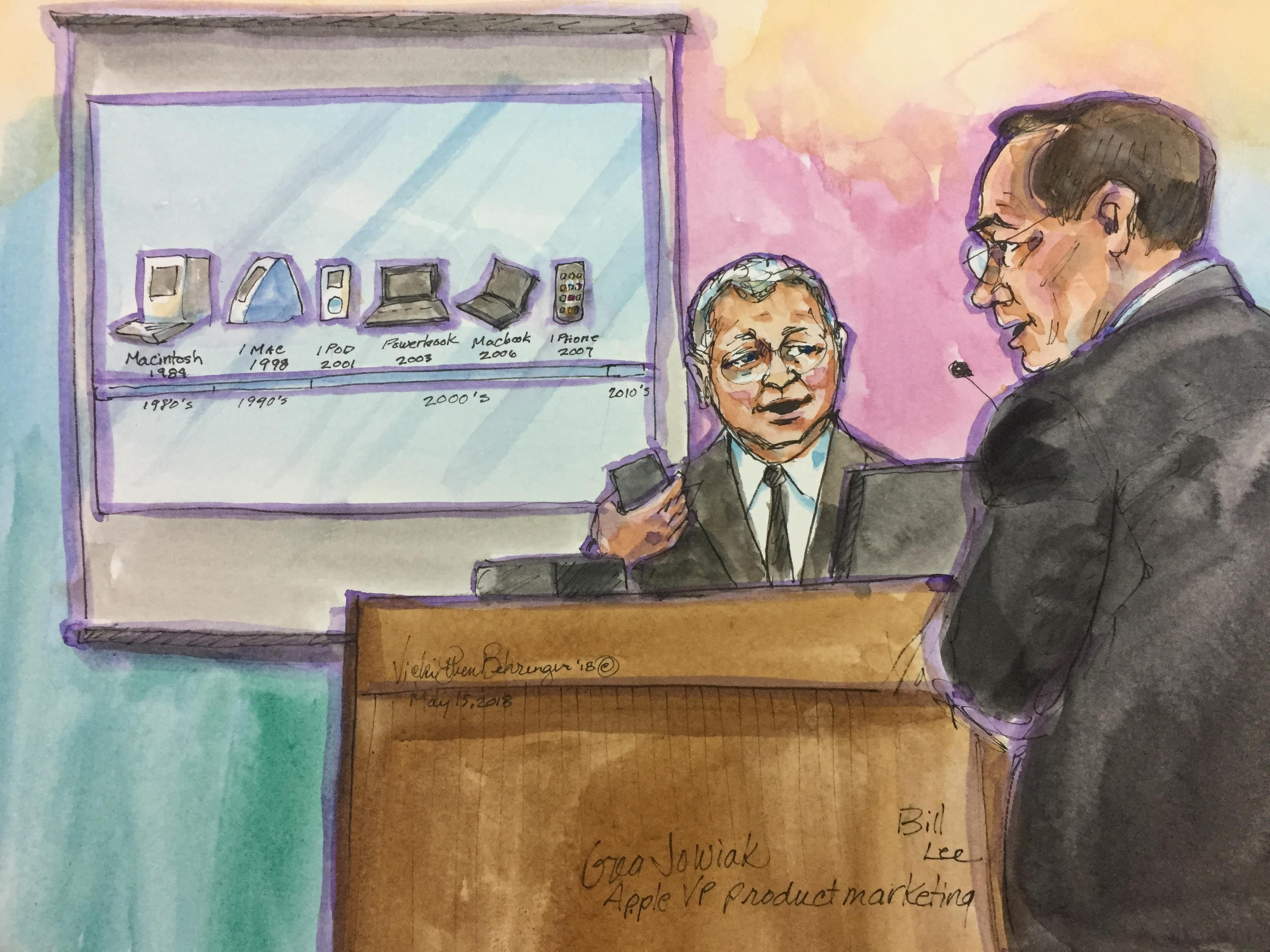 At a patent infringement damages trial, Greg Joswiak, Apple's vice president of product marketing, answers questions from Apple attorney Bill Lee about Apple's history of product design.