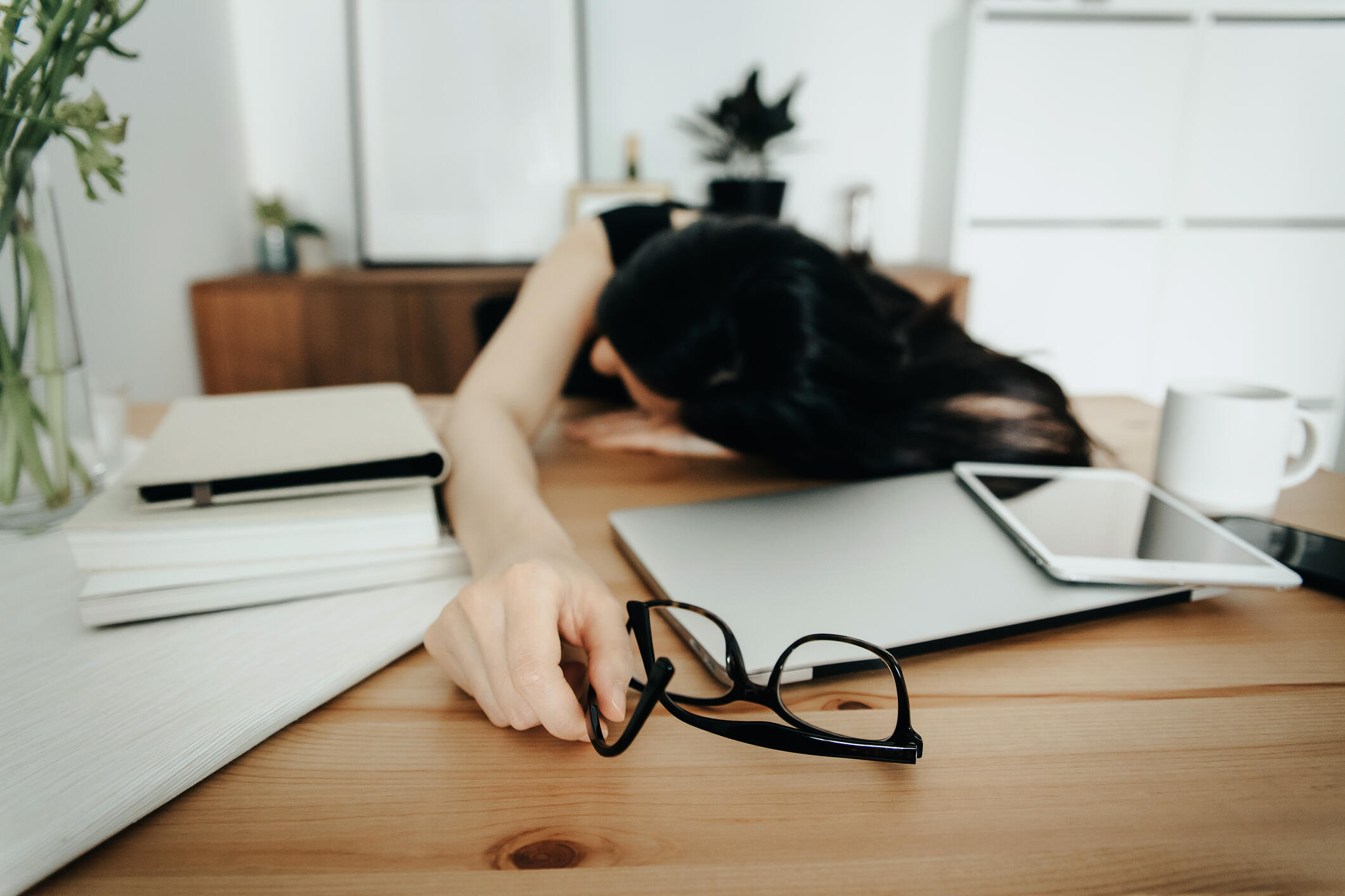woman stressed out sleeping at desk