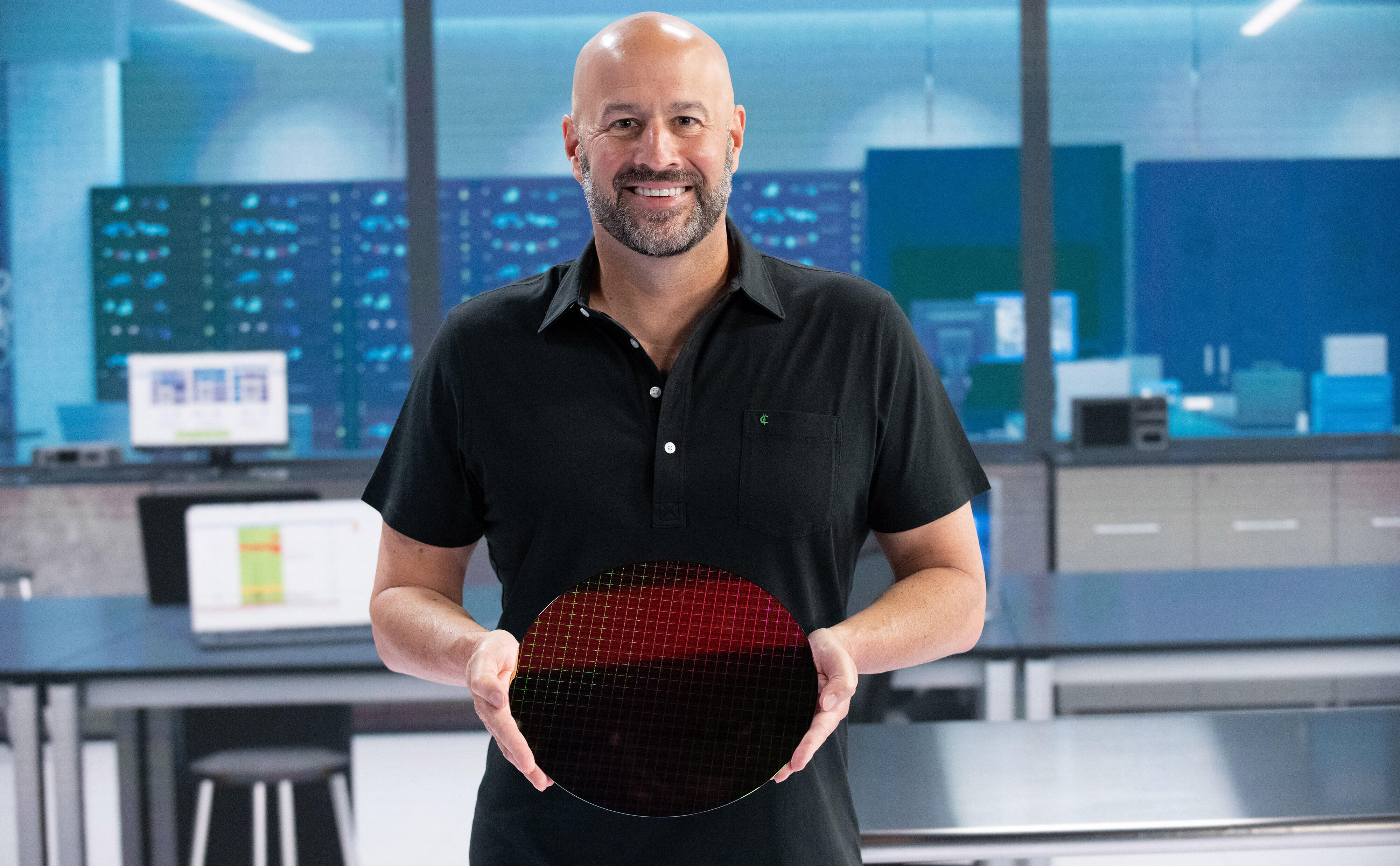 Gregory Bryant, leader of Intel's PC chip business, holds a 300mm wide wafer with hundreds of Tiger Lake processors.