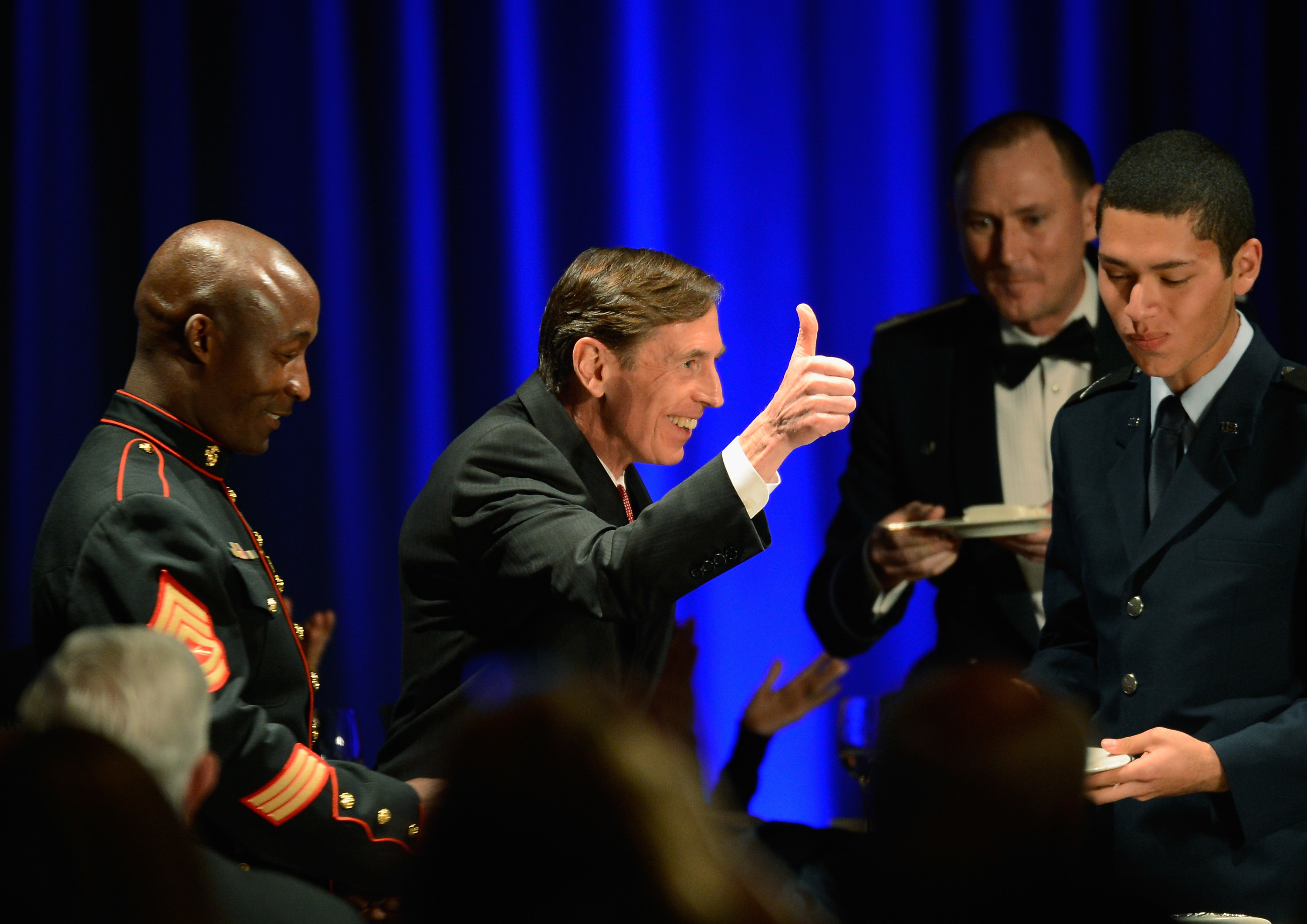 David Petraeus, shown here at an event in March 2013, resigned as CIA director last fall after an investigation into e-mail cyberstalking revealed an extramarital affair.