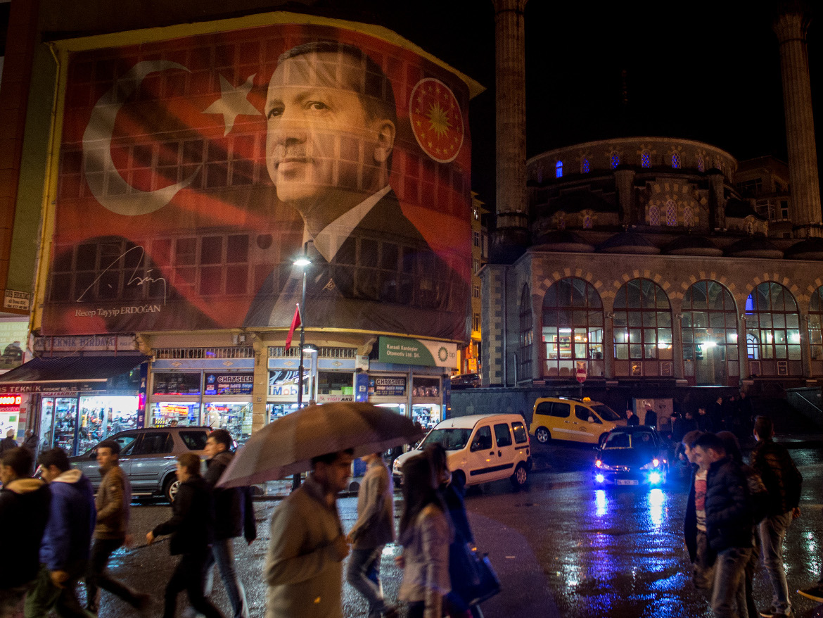 A banner depicting Turkish President Recep Tayyip Erdoğan overlooks a street in Rize, Turkey. The government has reportedly restricted access to social media in the country.