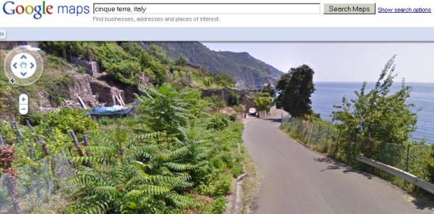 A Google Street View image of a coastal road in the Cinque Terre region of northern Italy.