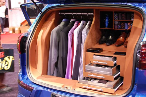 The blue Kia Sportage work concept features a Droid X cradle and a full wardrobe out back.