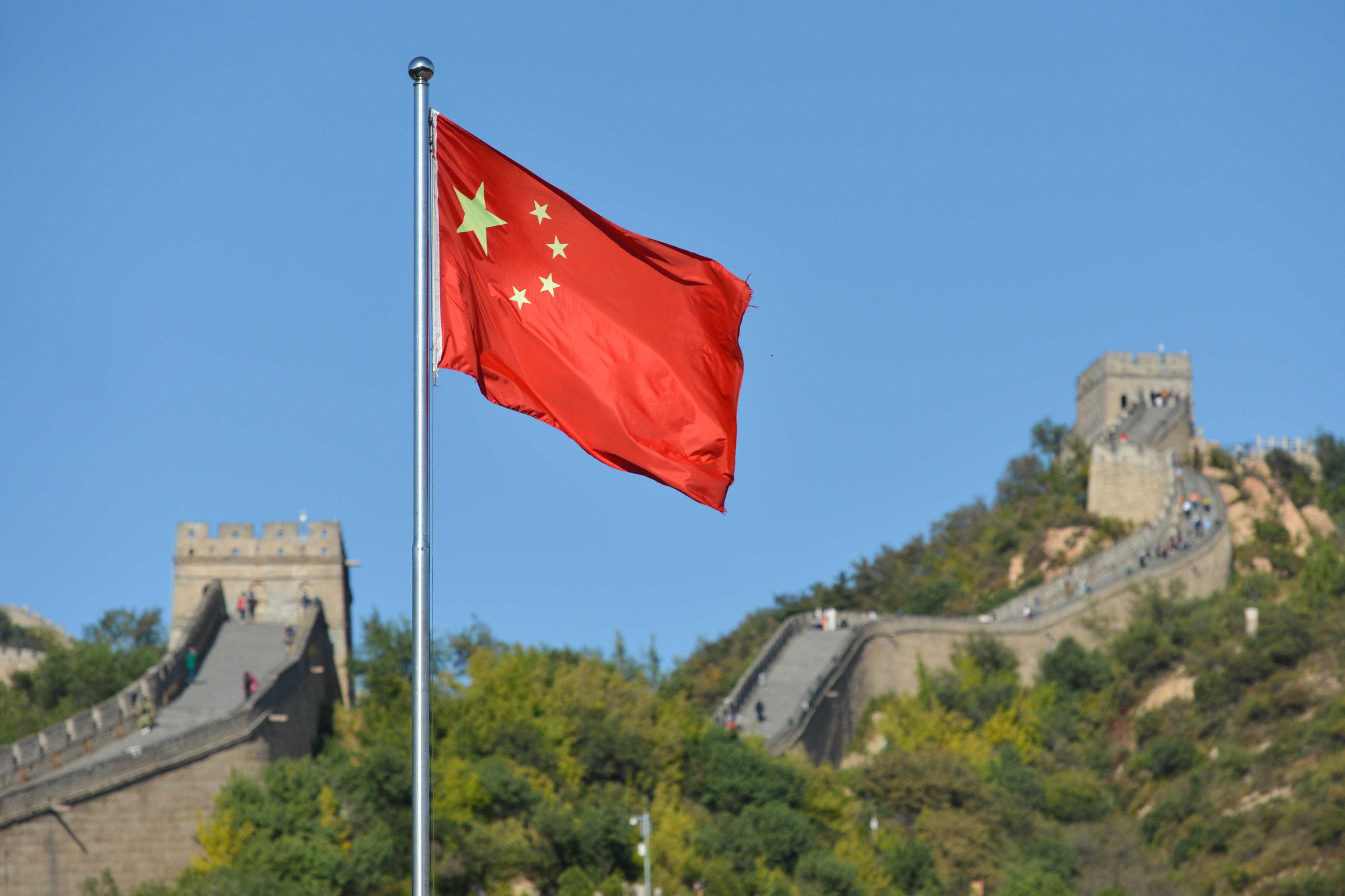 China's flag in front of the Great Wall
