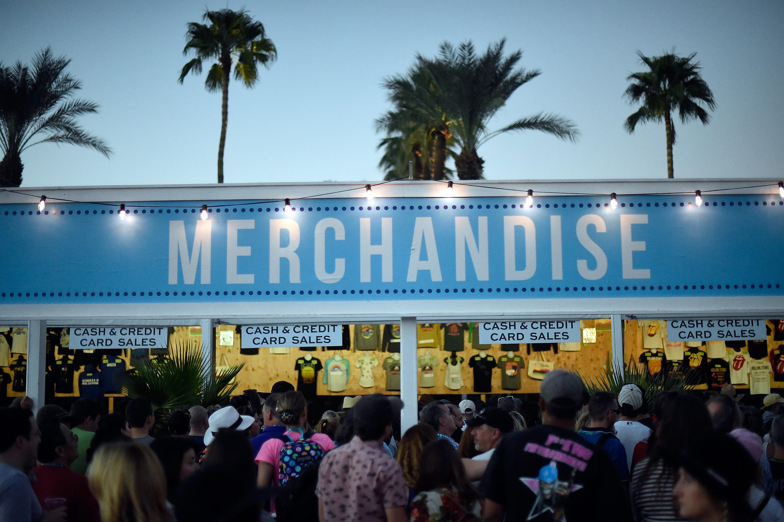 A merchandise stand in front of palm trees