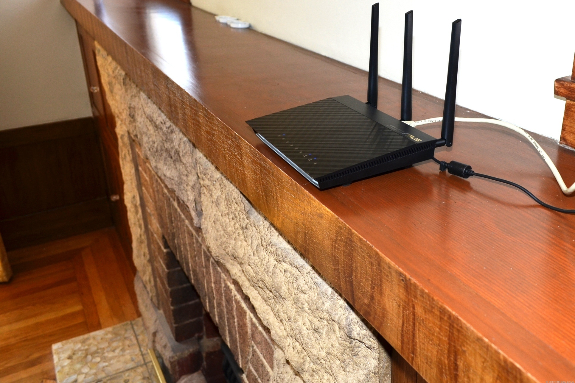 The top of the fireplace in the living room is a good spot to leave your Wi-Fi router for the best coverage.